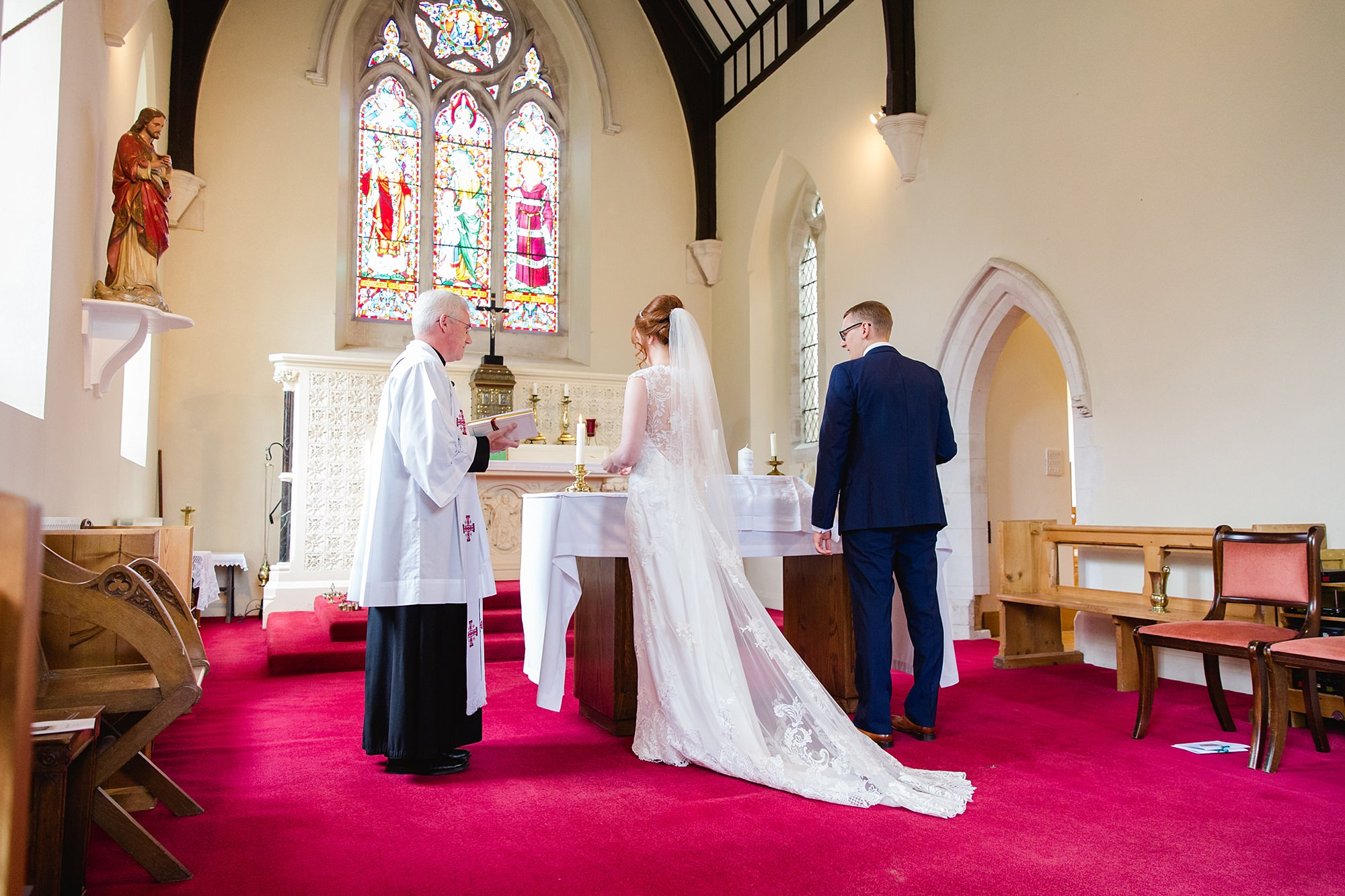 Canon Lane Chichester wedding bride and groom lighting candle