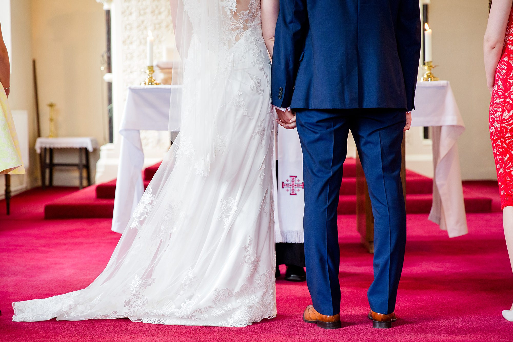 Canon Lane Chichester wedding bride and groom hold hands during ceremony