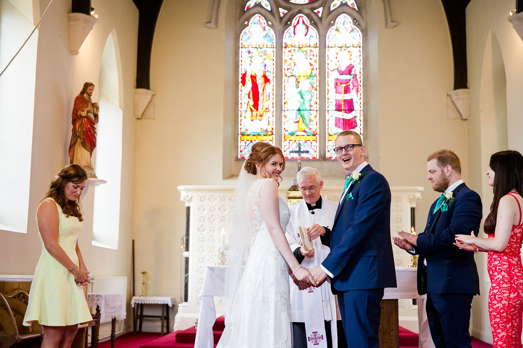 Canon Lane Chichester wedding bride and groom laugh together