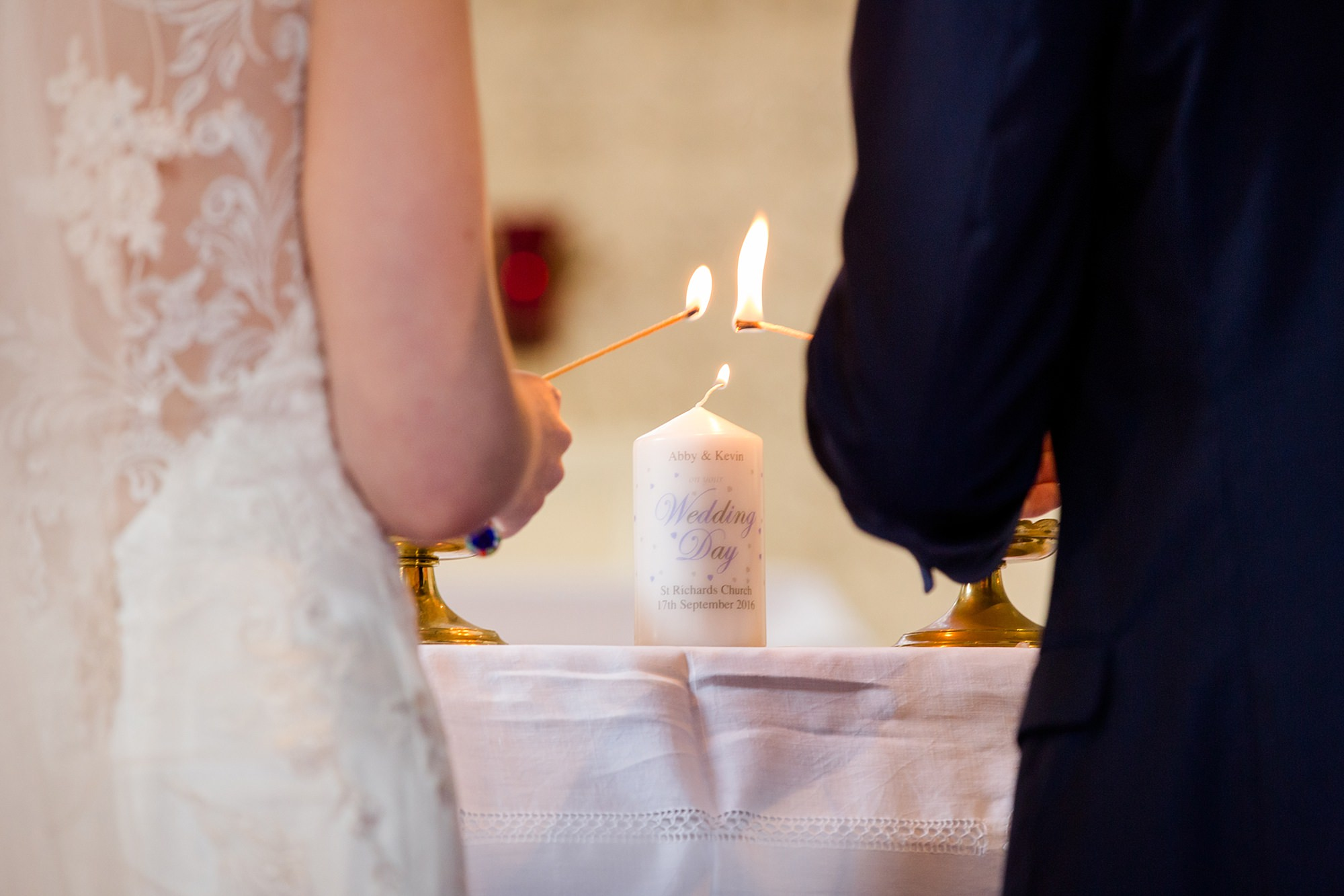 Canon Lane Chichester wedding bride and groom light candle