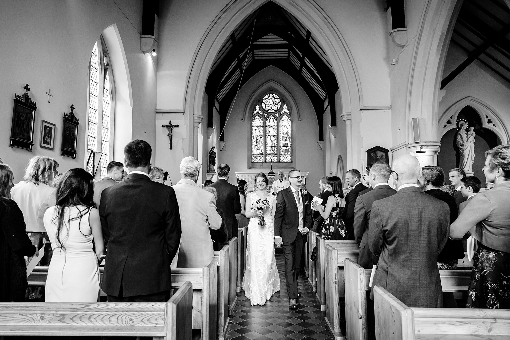 Canon Lane Chichester wedding bride and groom walk back down the aisle