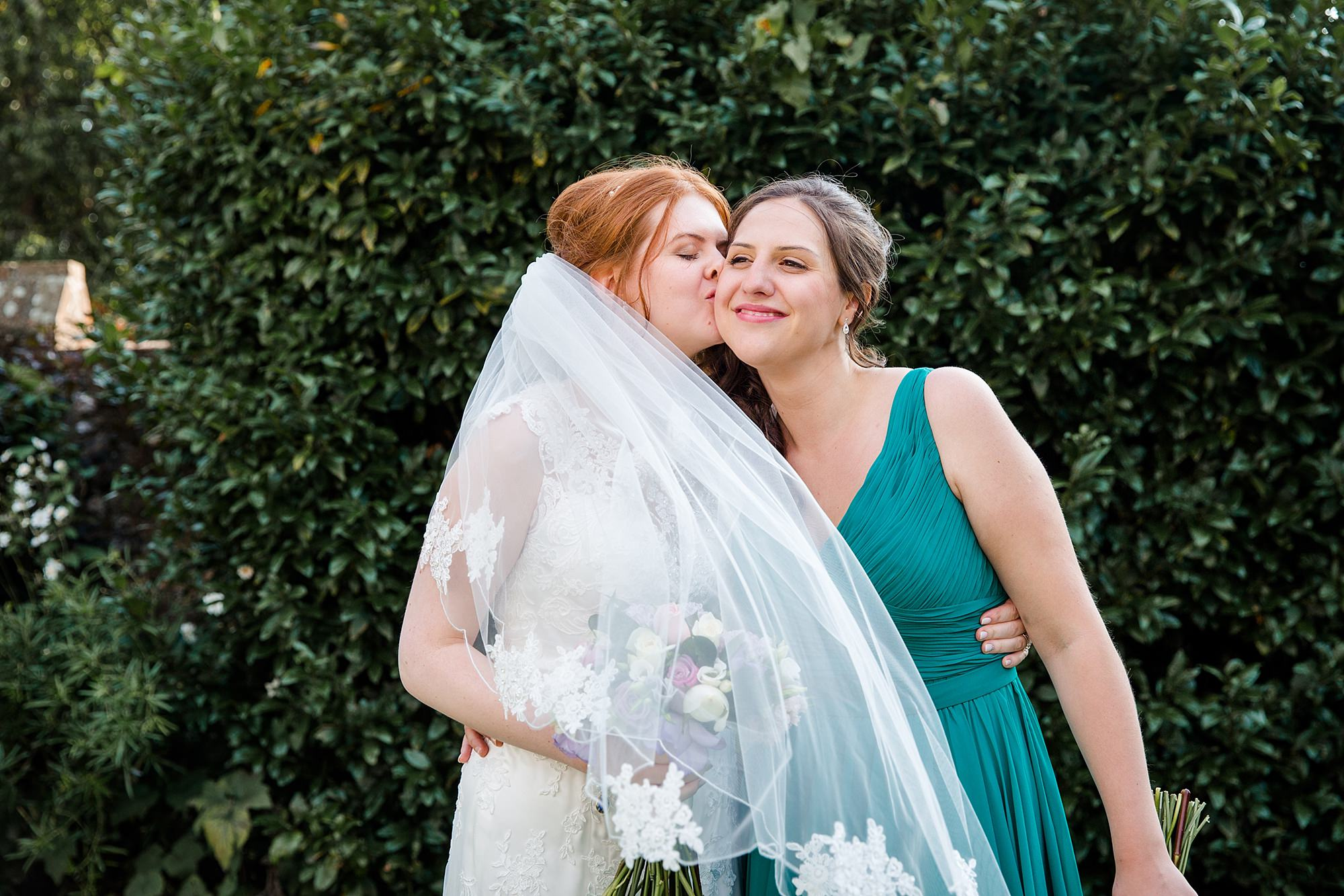 Canon Lane Chichester wedding bride hugs bridesmaid