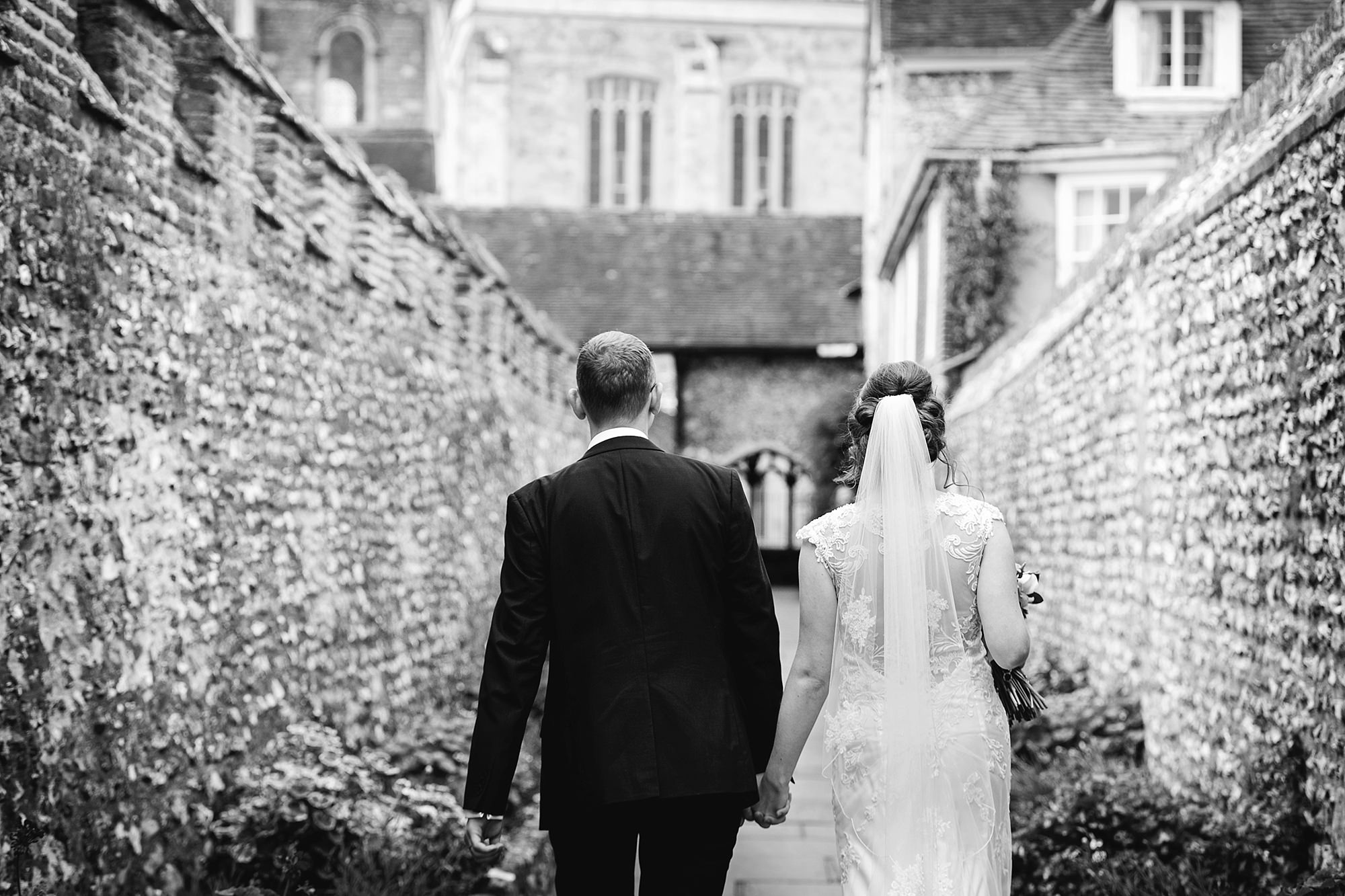 Canon Lane Chichester wedding bride and groom walking together