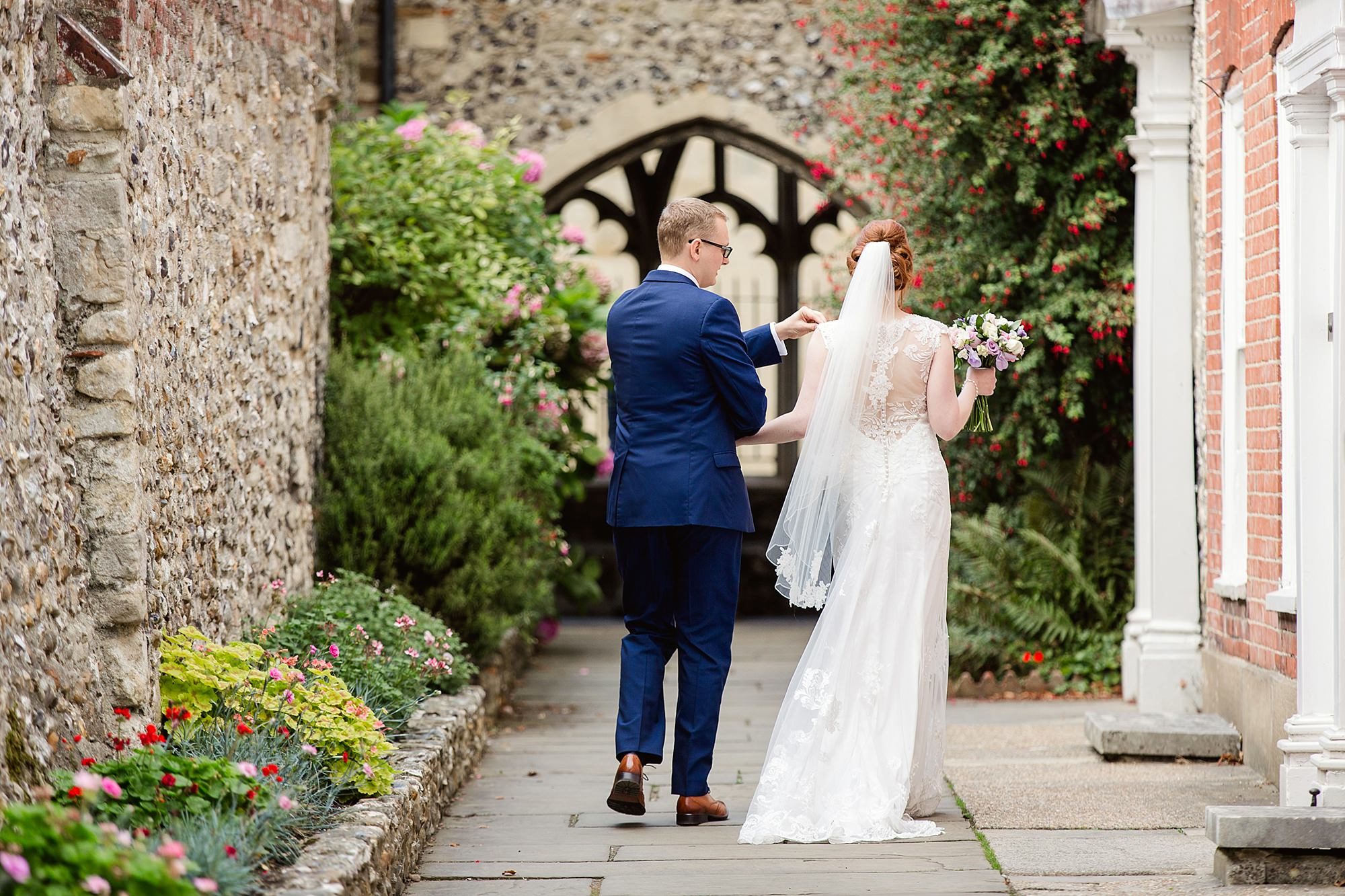Canon Lane Chichester wedding bride and groom walk towards cathedral