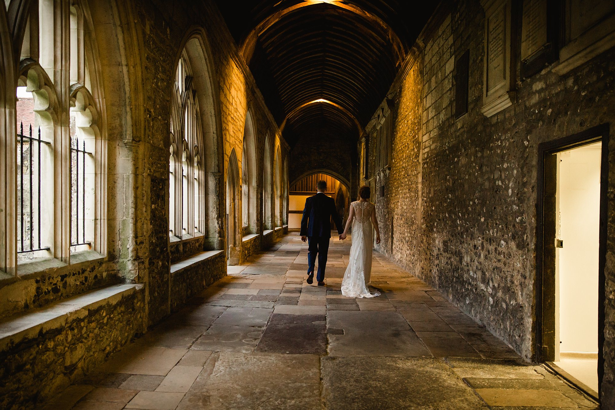 Canon Lane Chichester wedding bride and groom walking through cloisters
