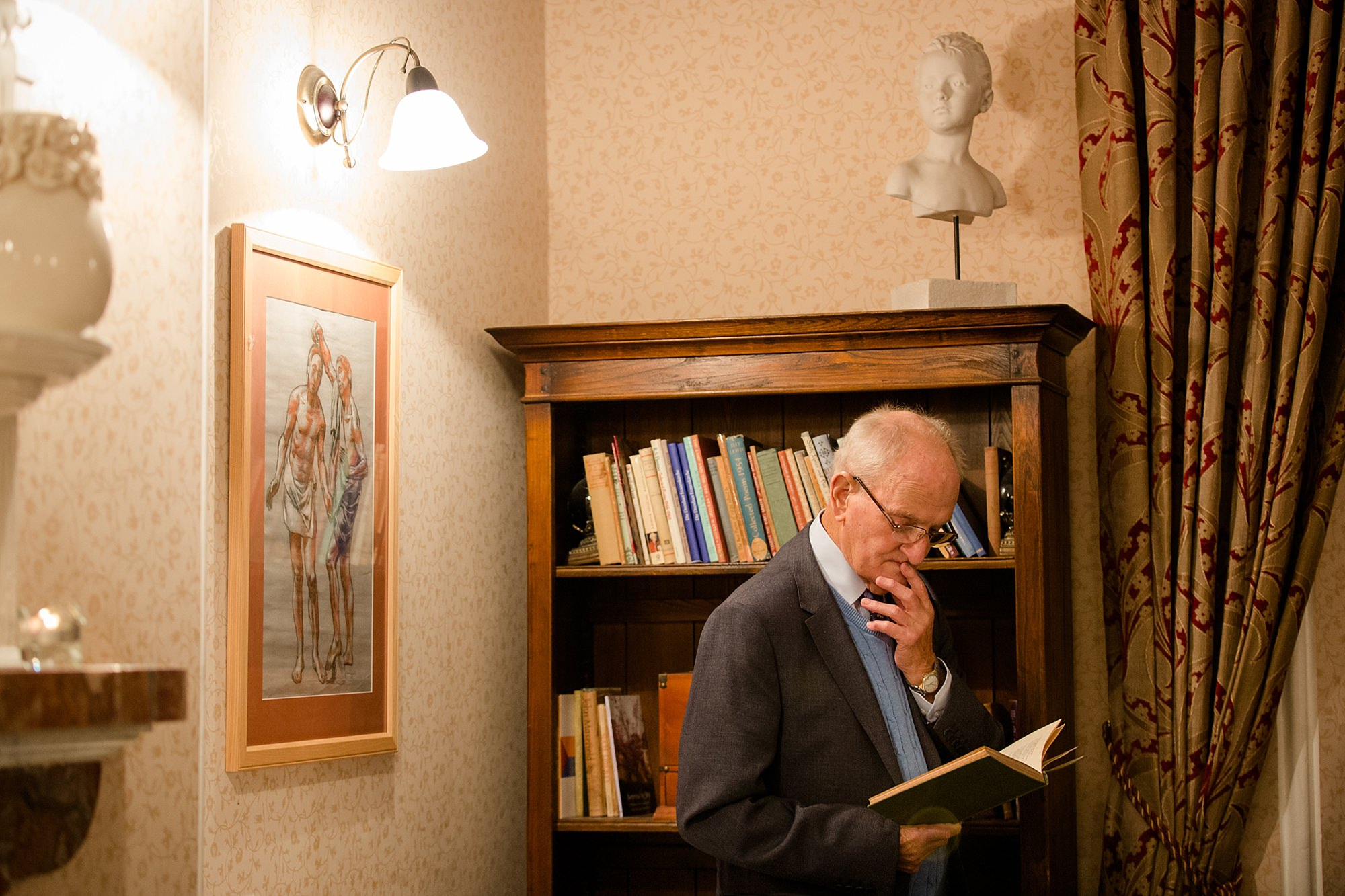 Canon Lane Chichester wedding guest reading a book