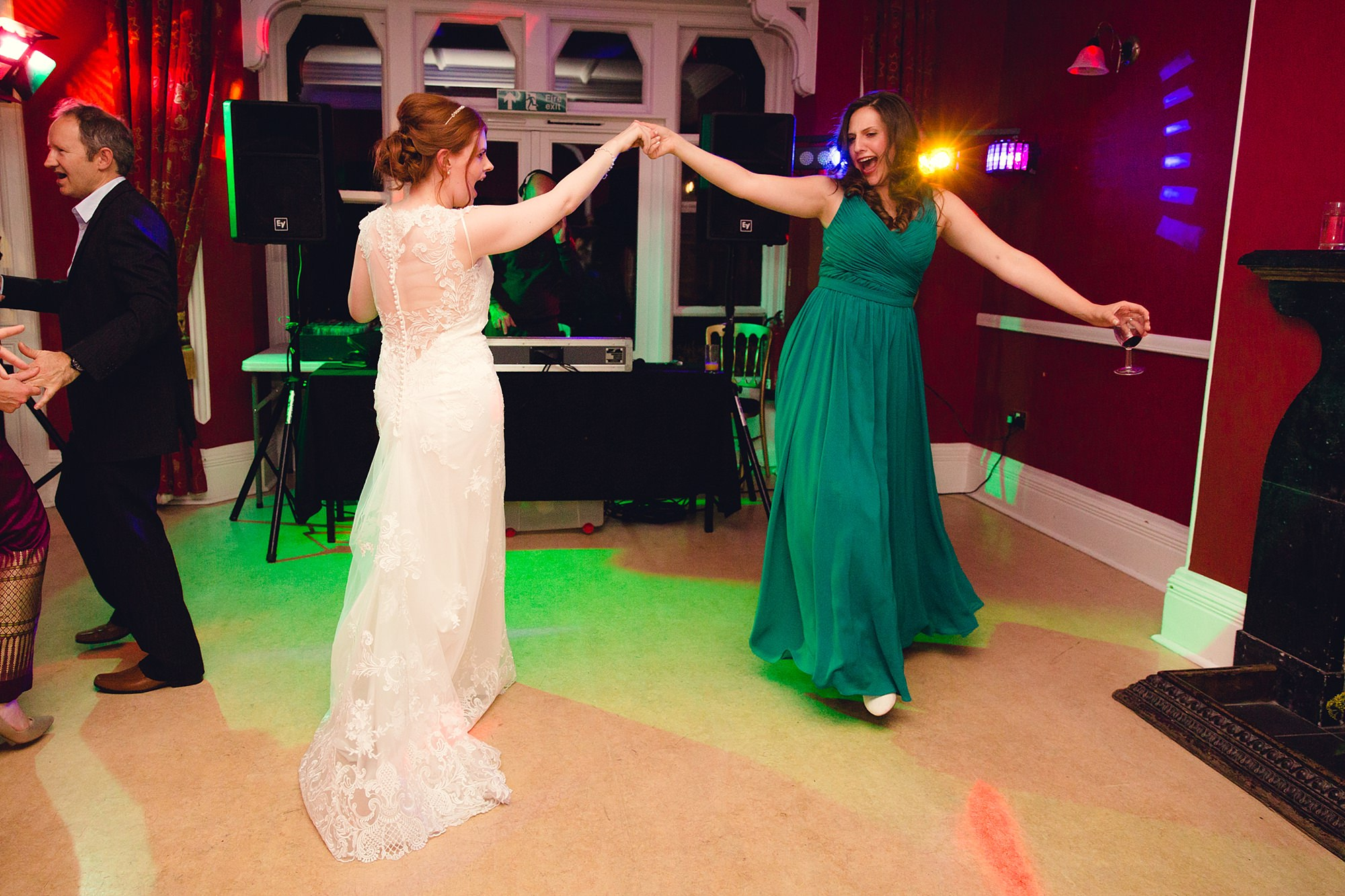 Canon Lane Chichester wedding bride dances with bridesmaid