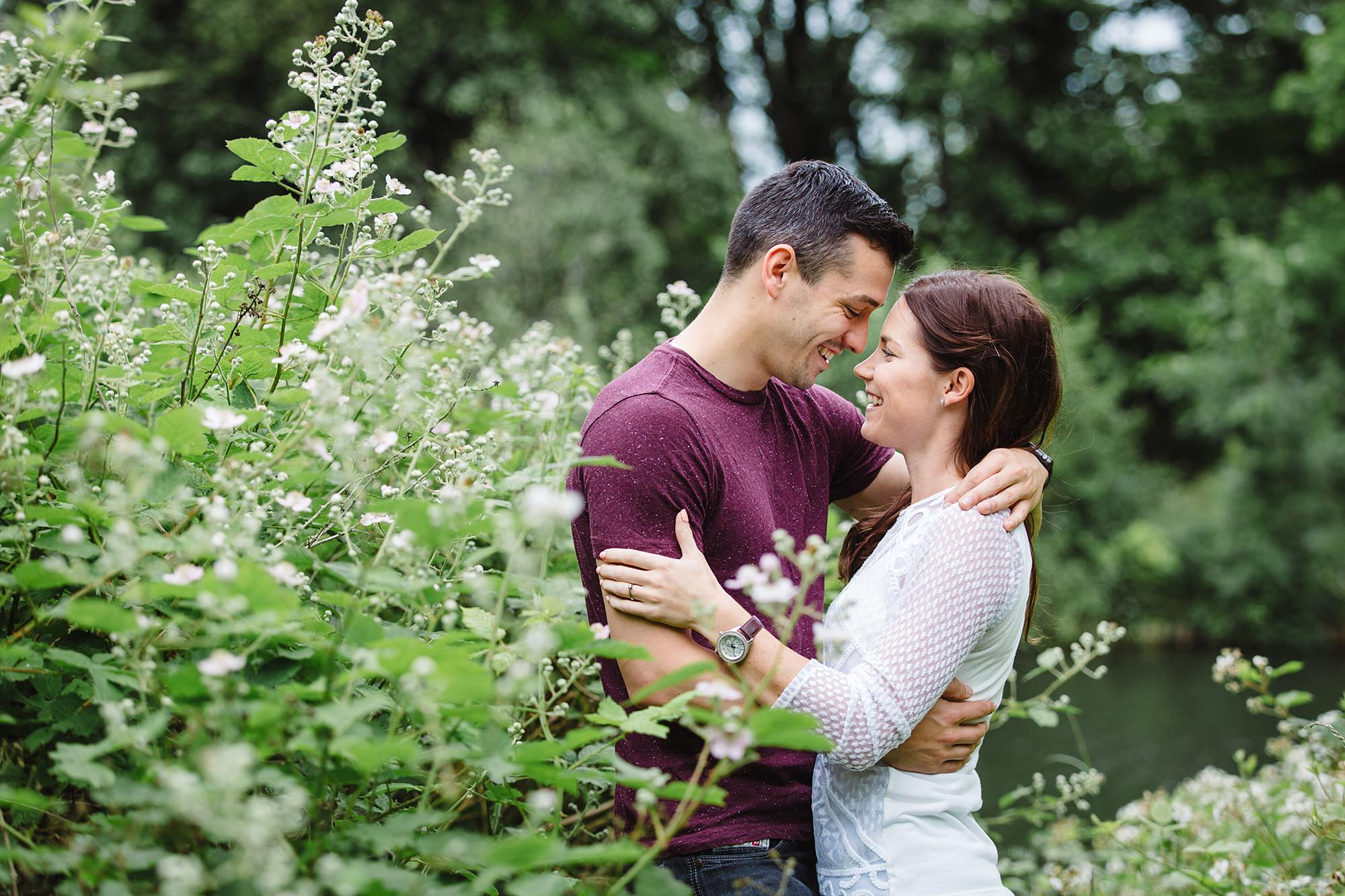 Countryside engagement photography - portrait of a couple hugging in the countryside