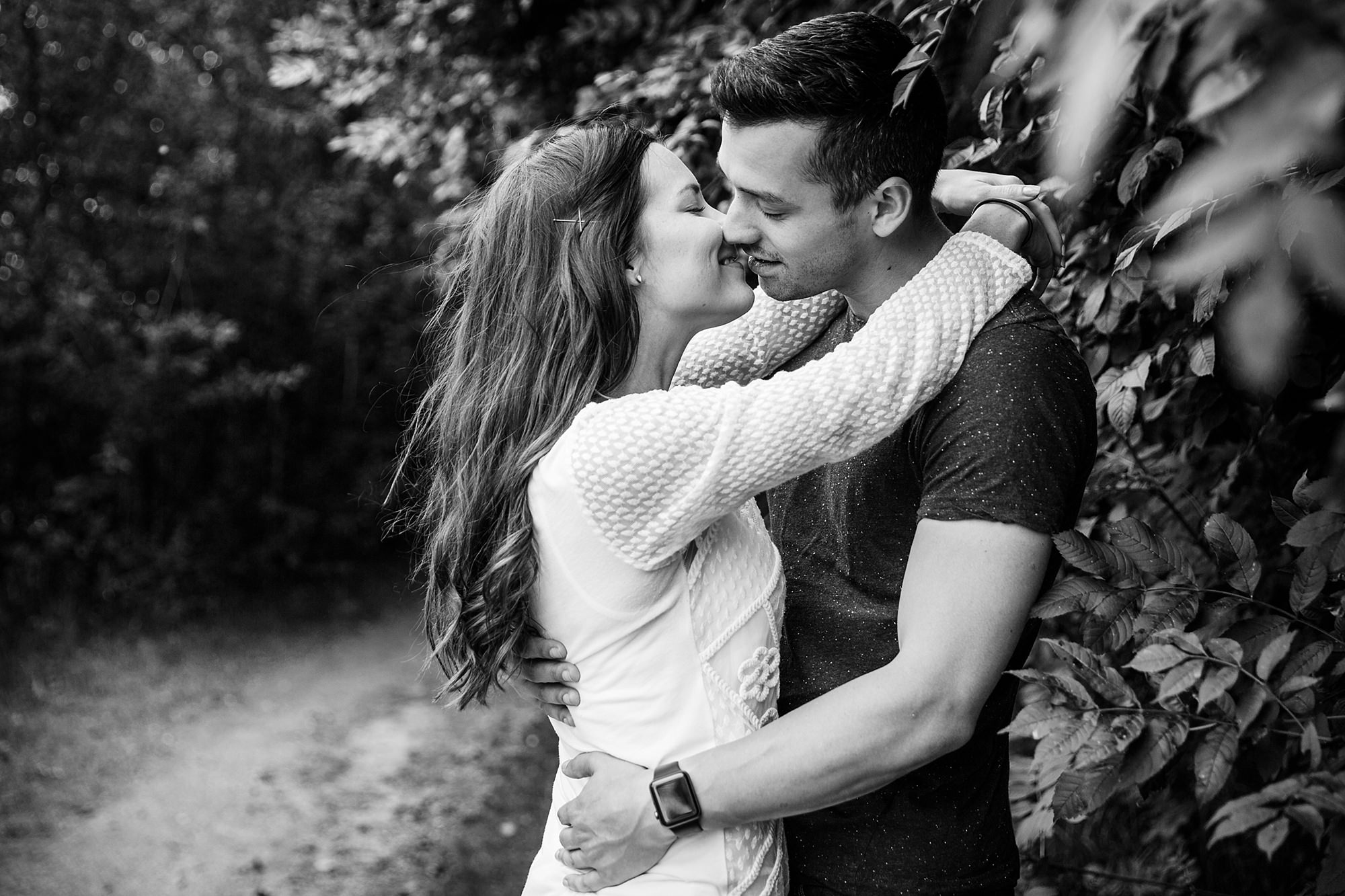 Countryside engagement photography - portrait of couple kissing