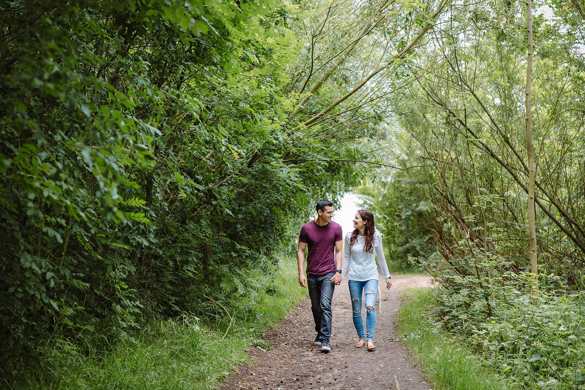 Countryside engagement photography - a couple walking together