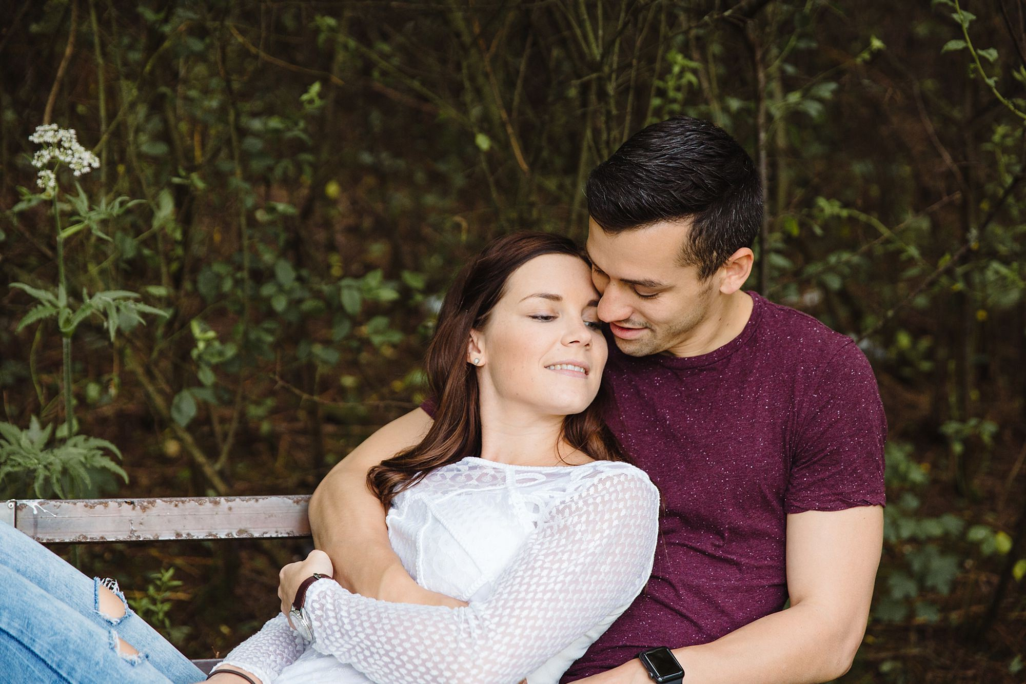 Countryside engagement photography close up portrait of couple on bench