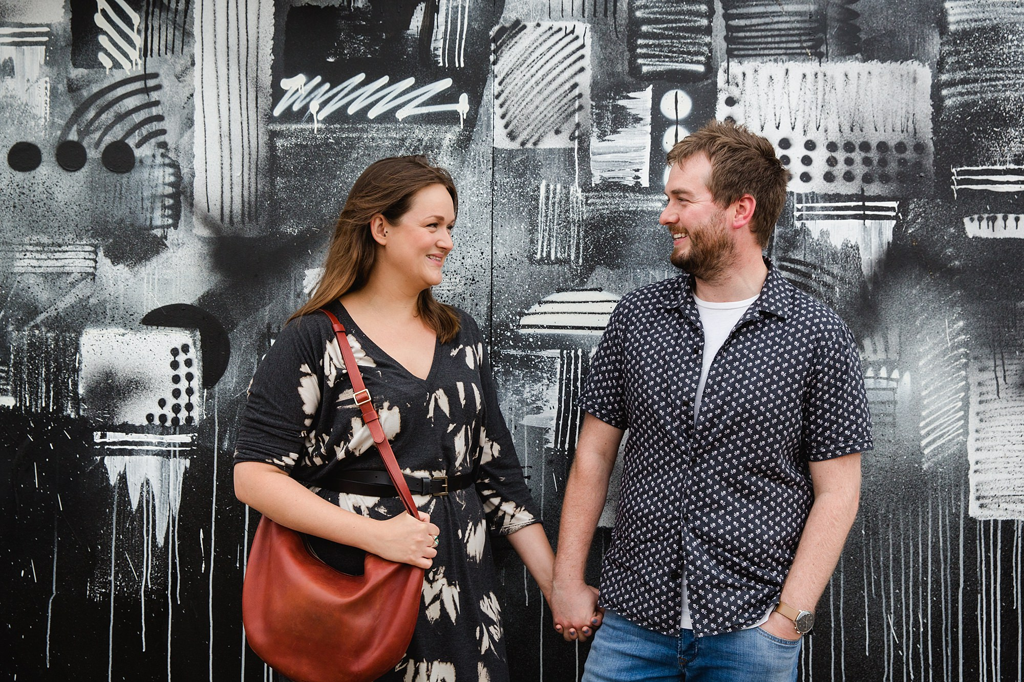 Croydon engagement photography - portrait of couple in front of graffiti