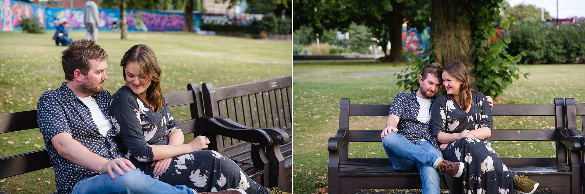 Croydon engagement photography portrait of couple sat on bench