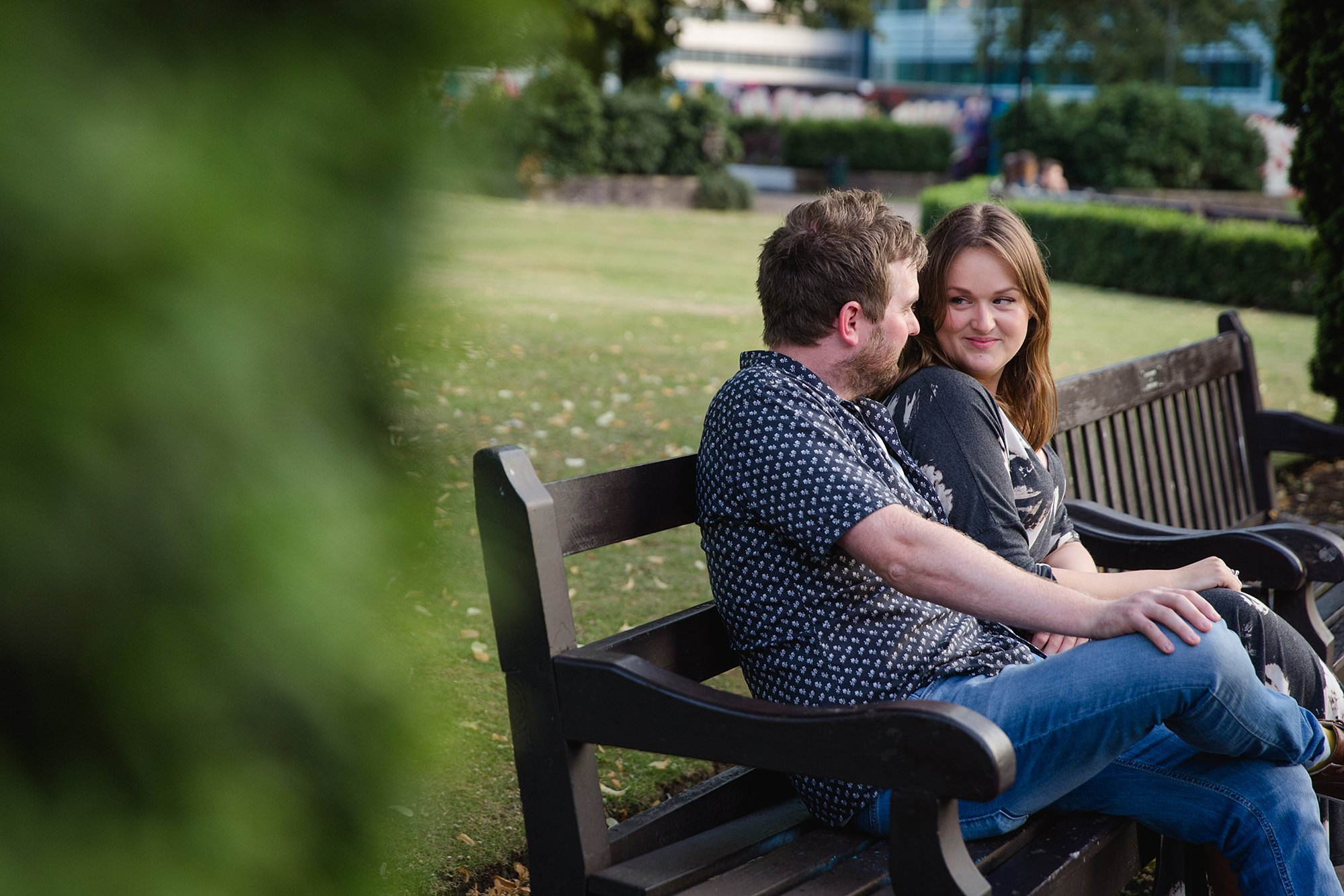 Croydon engagement photography - a couple sits together on a bench