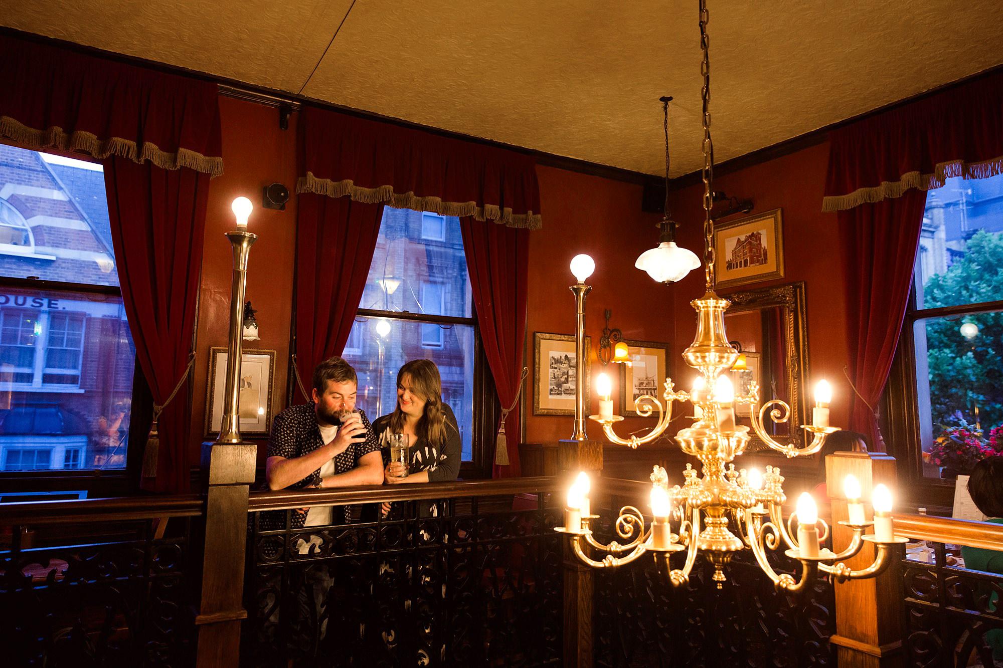 Croydon engagement photography portrait of a couple having a pint