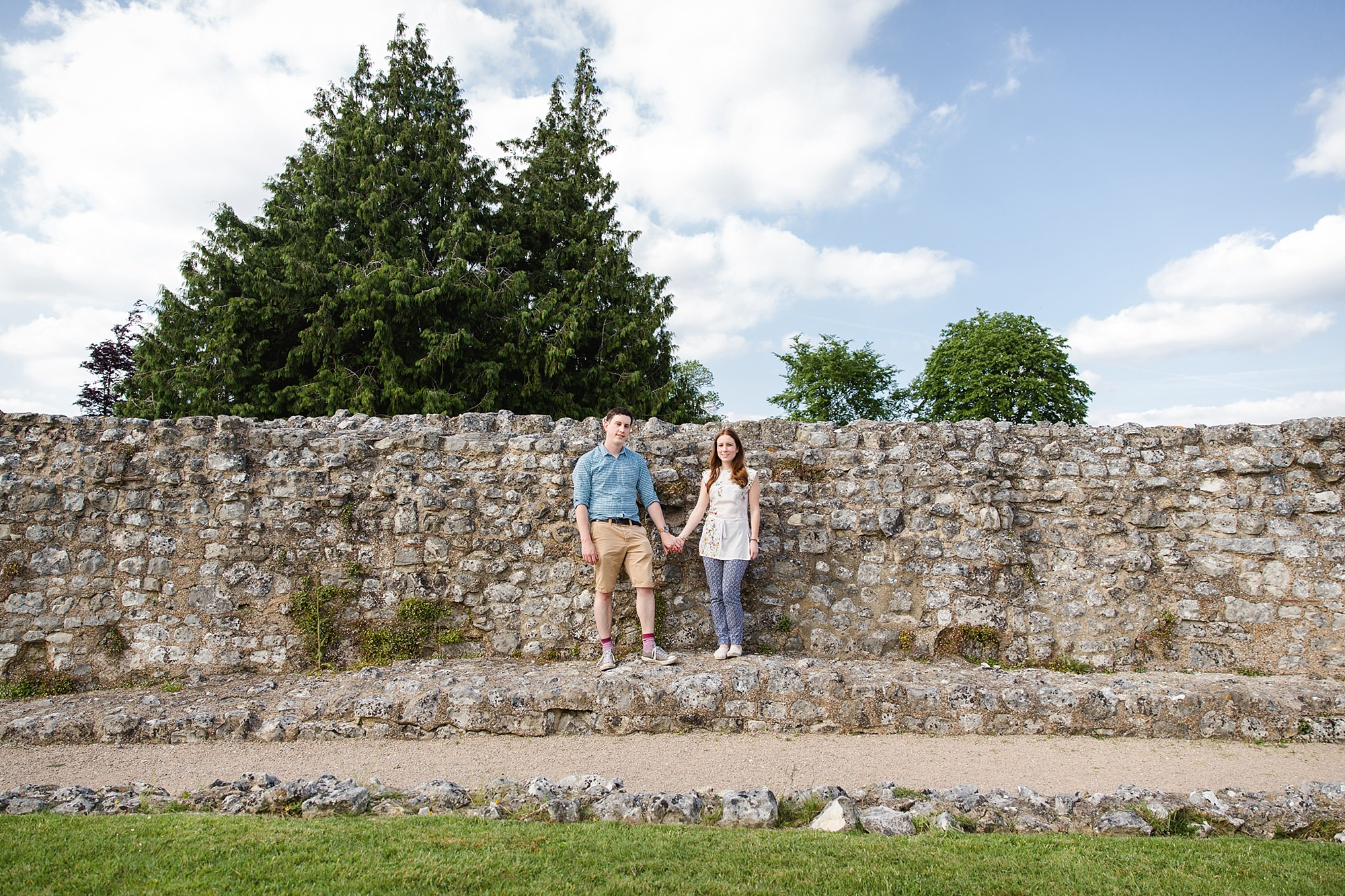 Farnham engagement photography portrait of couple by castle walls