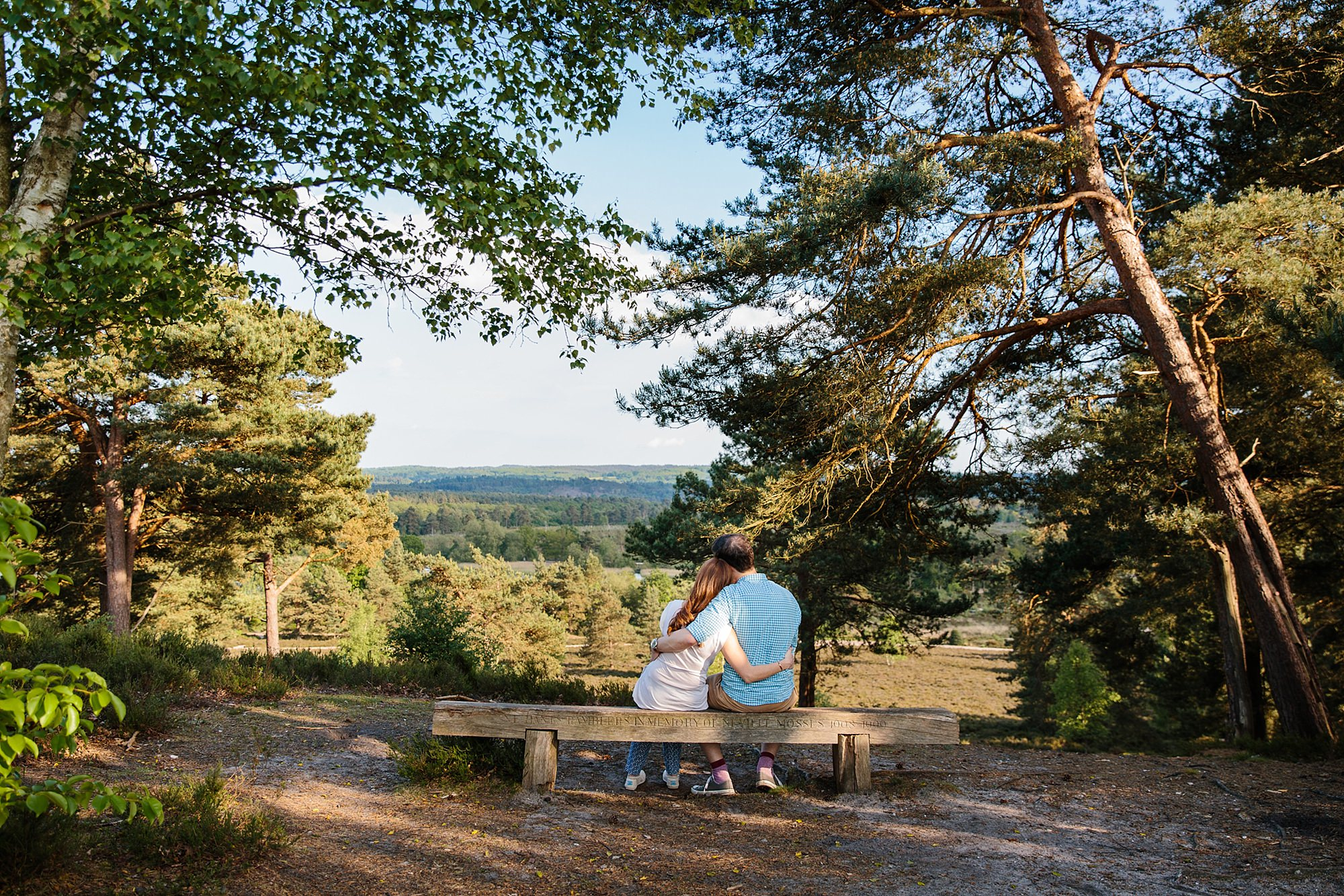 Farnham engagement photography portrait of a couple on the hill above frensham pond