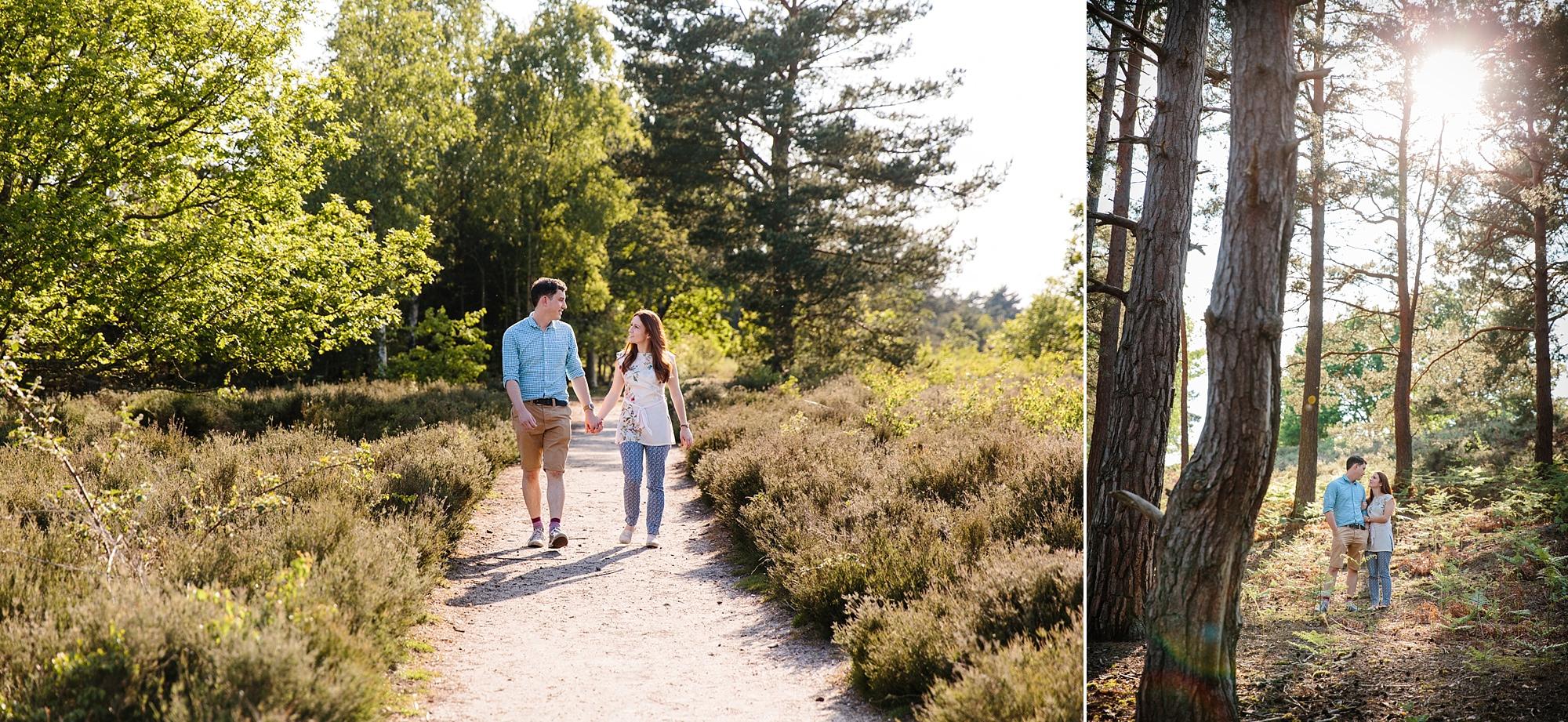 Farnham engagement photography a couple walks through the countryside at frensham
