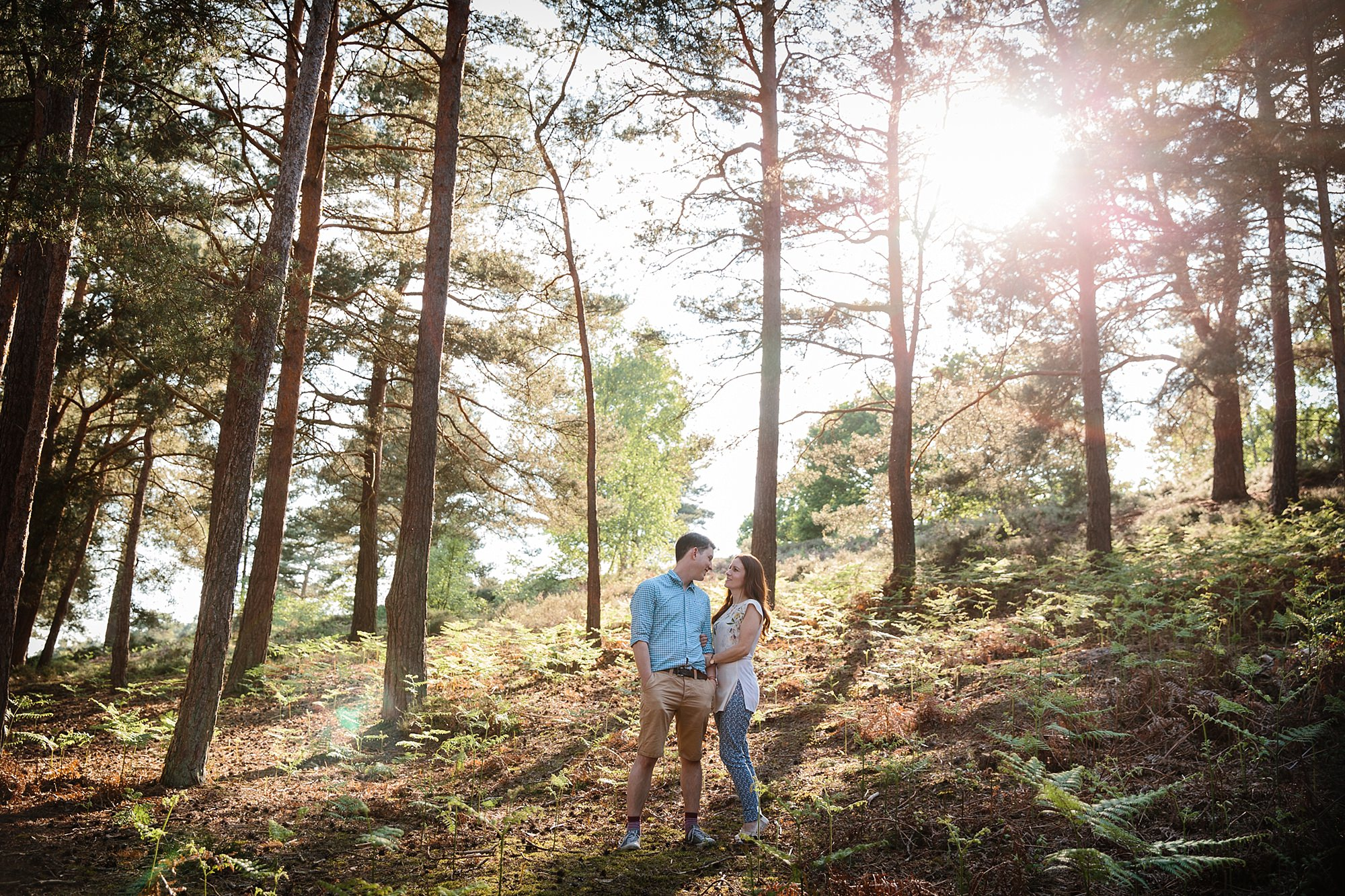 Farnham engagement photography portrait of couple together in forest
