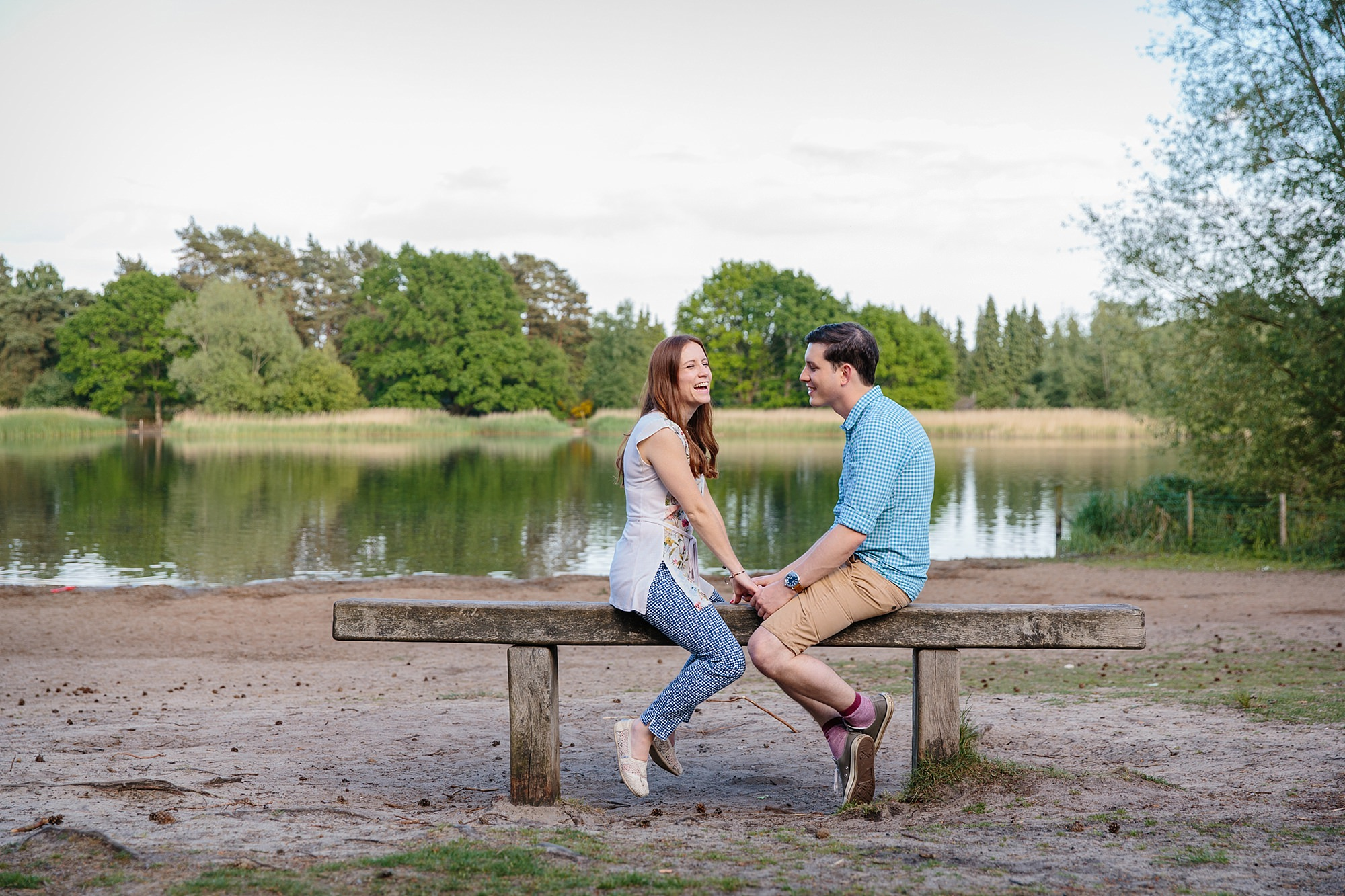 Farnham engagement photography portrait of a couple by frensham pond