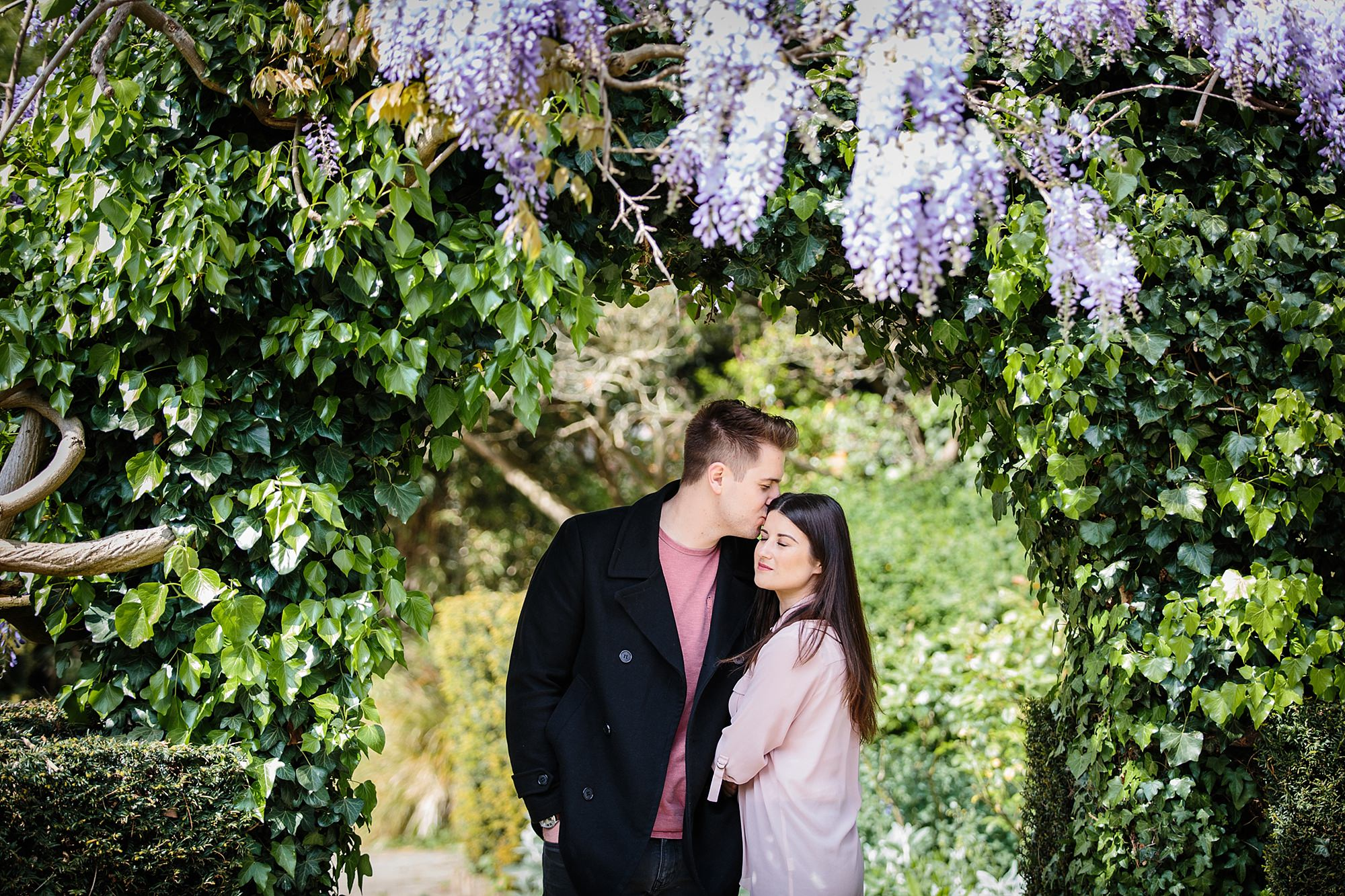 Streatham engagement shoot couple under Wisteria