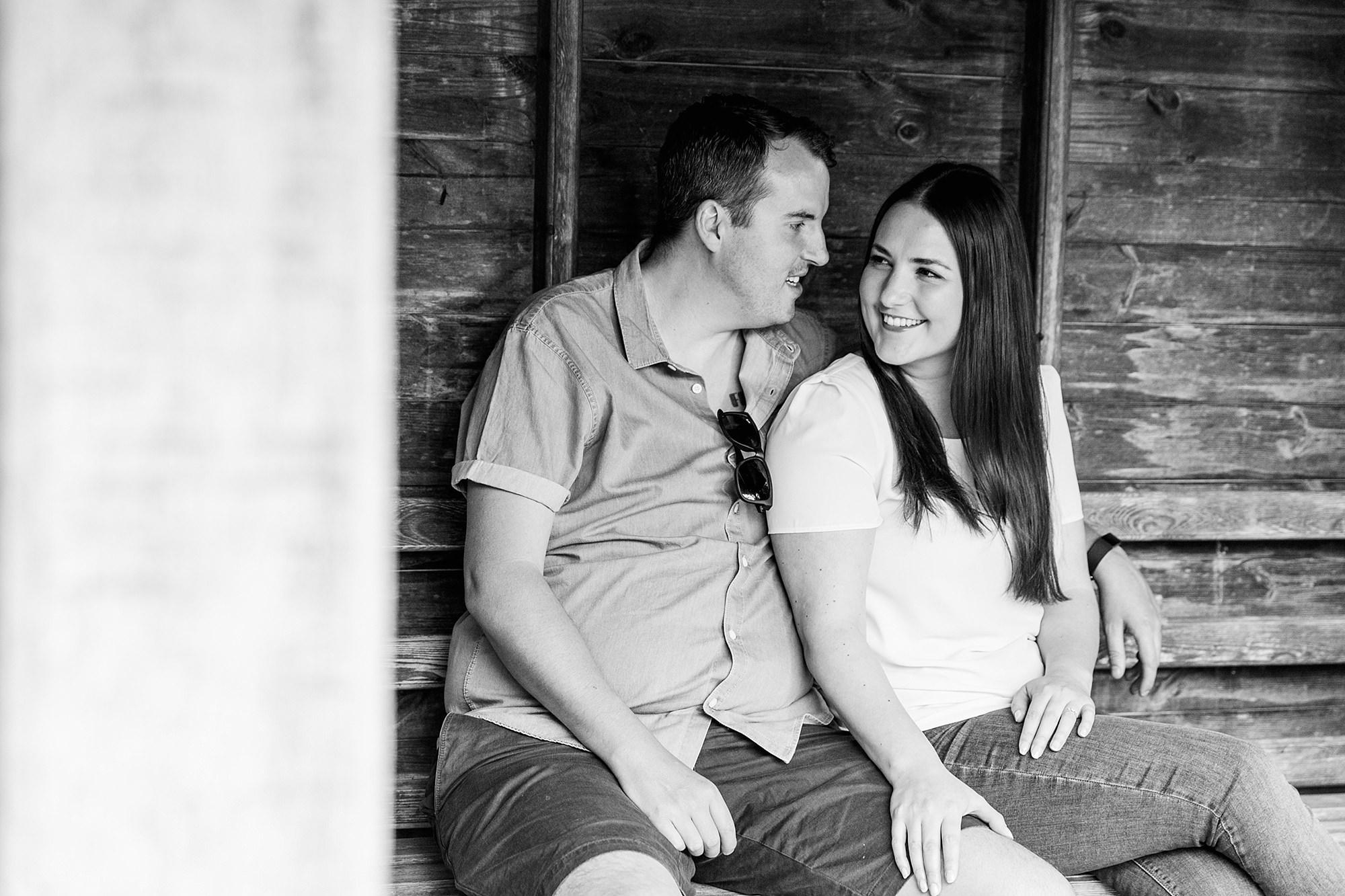 Tonbridge engagement photography couple sat on bench