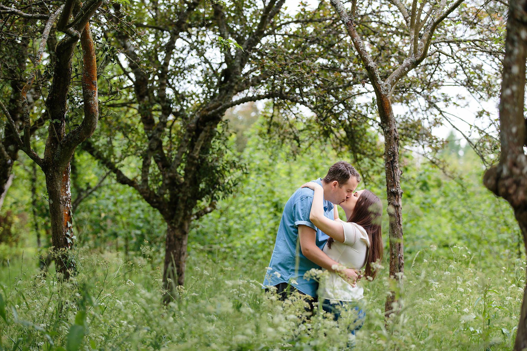 Tonbridge engagement photography couple kissing amongst trees