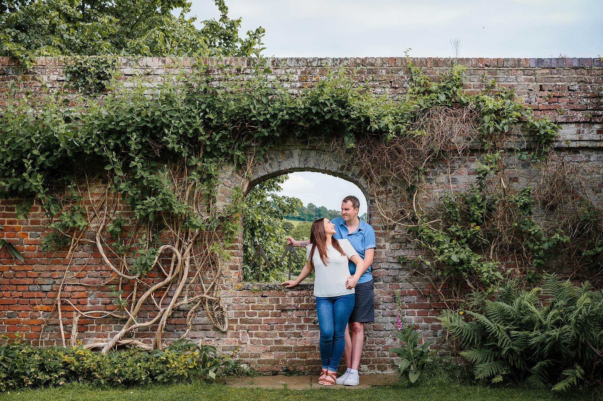 Tonbridge engagement photography portrait of couple stood under archway