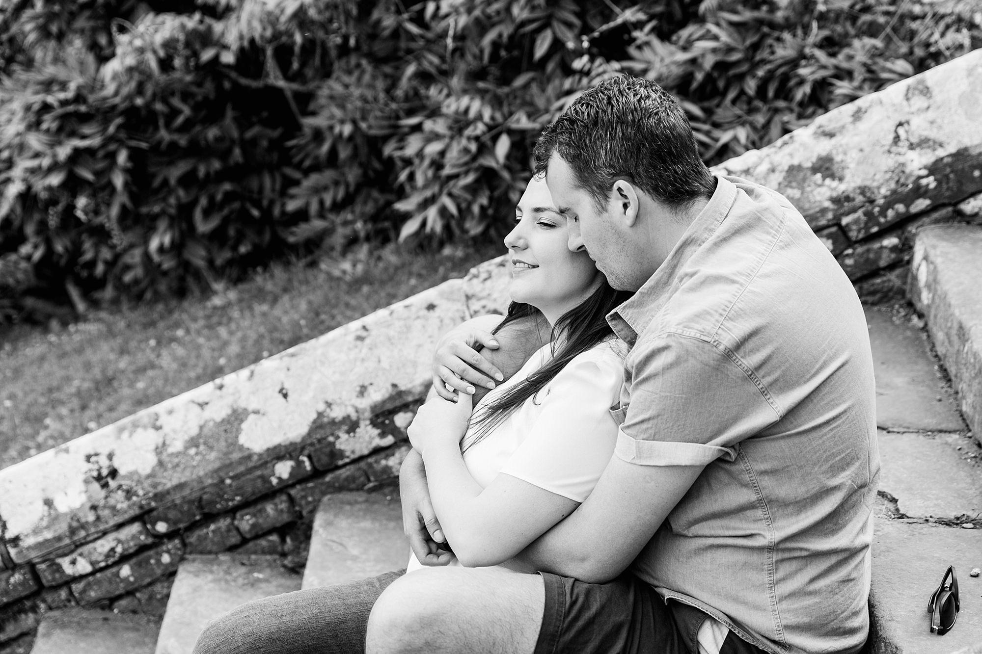 Tonbridge engagement photography portrait of a couple sat on steps