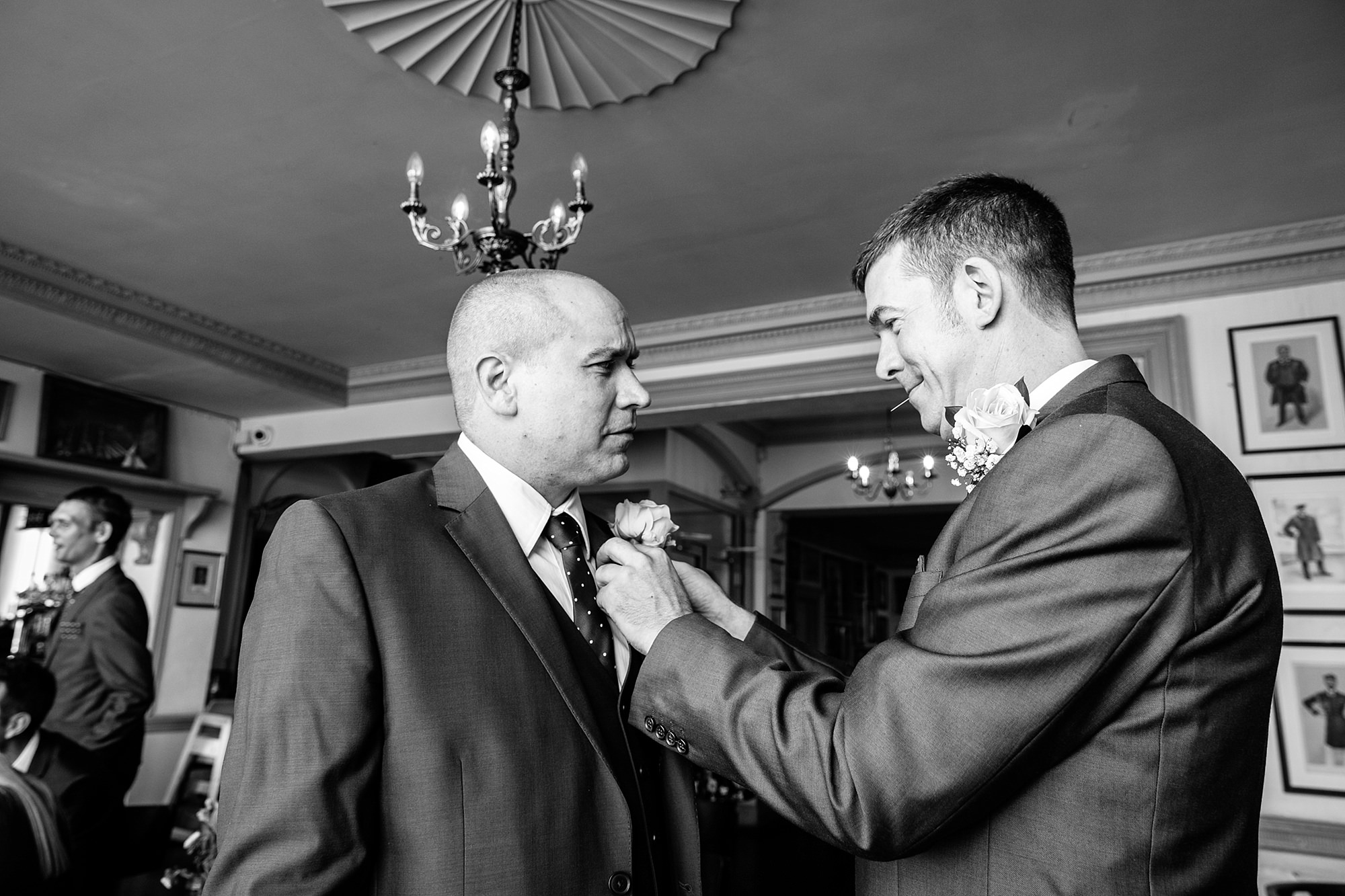 Trafalgar Tavern wedding groom and best man with buttonholes