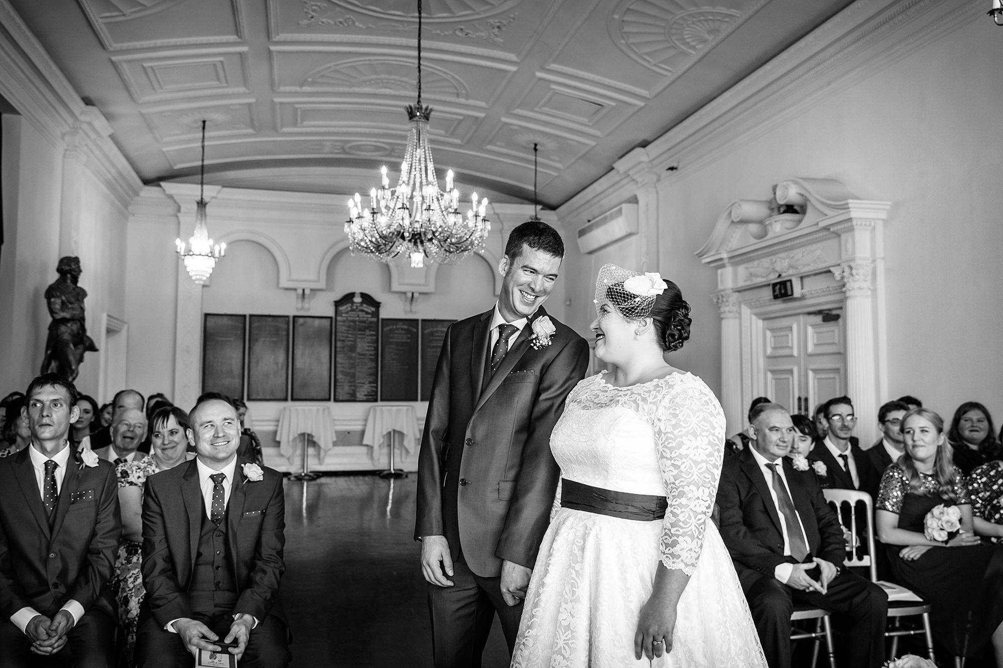 Trafalgar Tavern wedding bride and groom laugh during ceremony