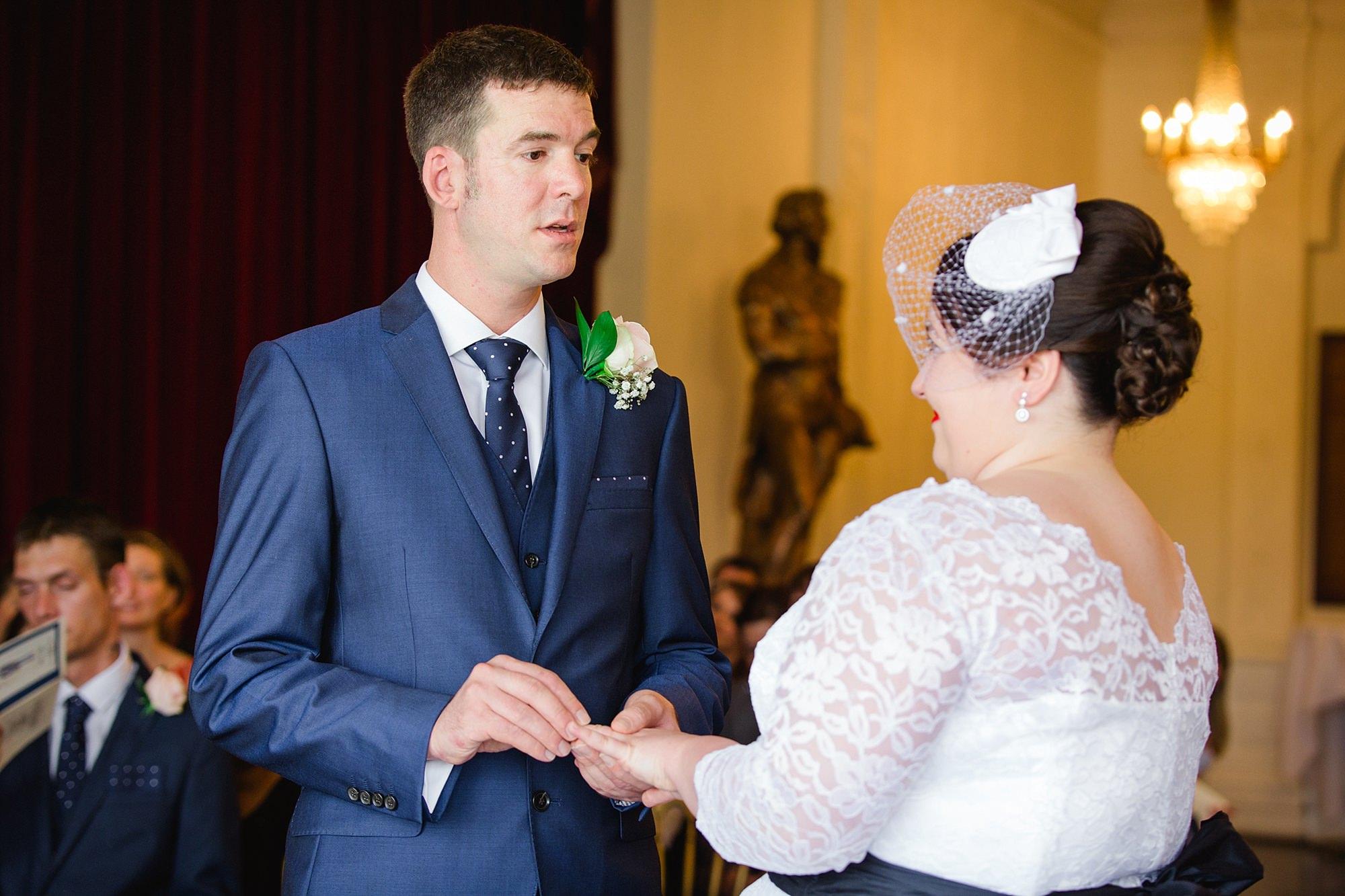 Trafalgar Tavern wedding from gives ring to bride