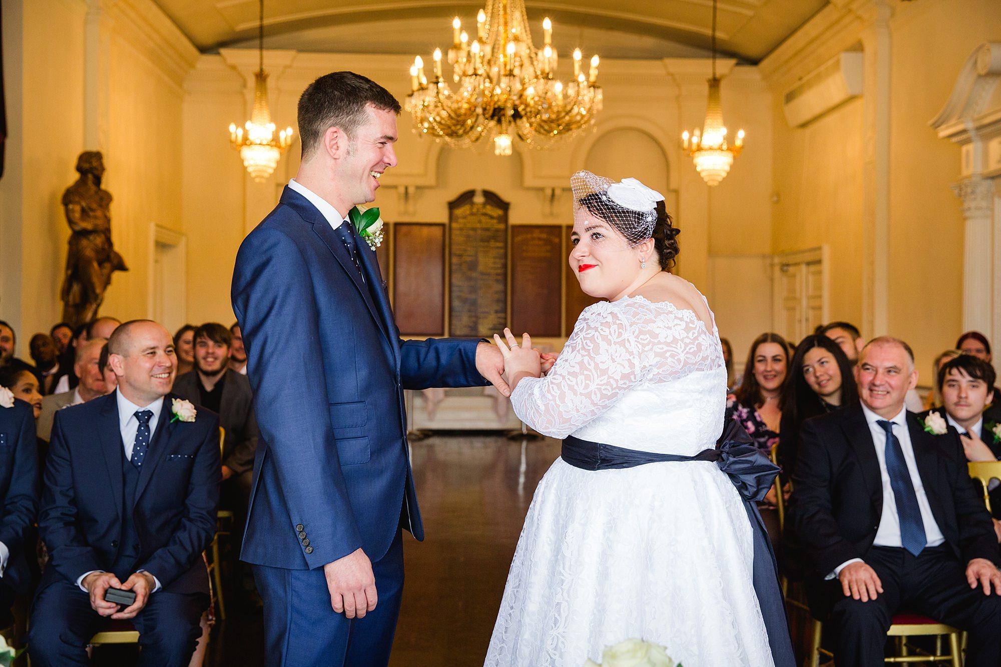 Trafalgar Tavern wedding bride giving ring to groom