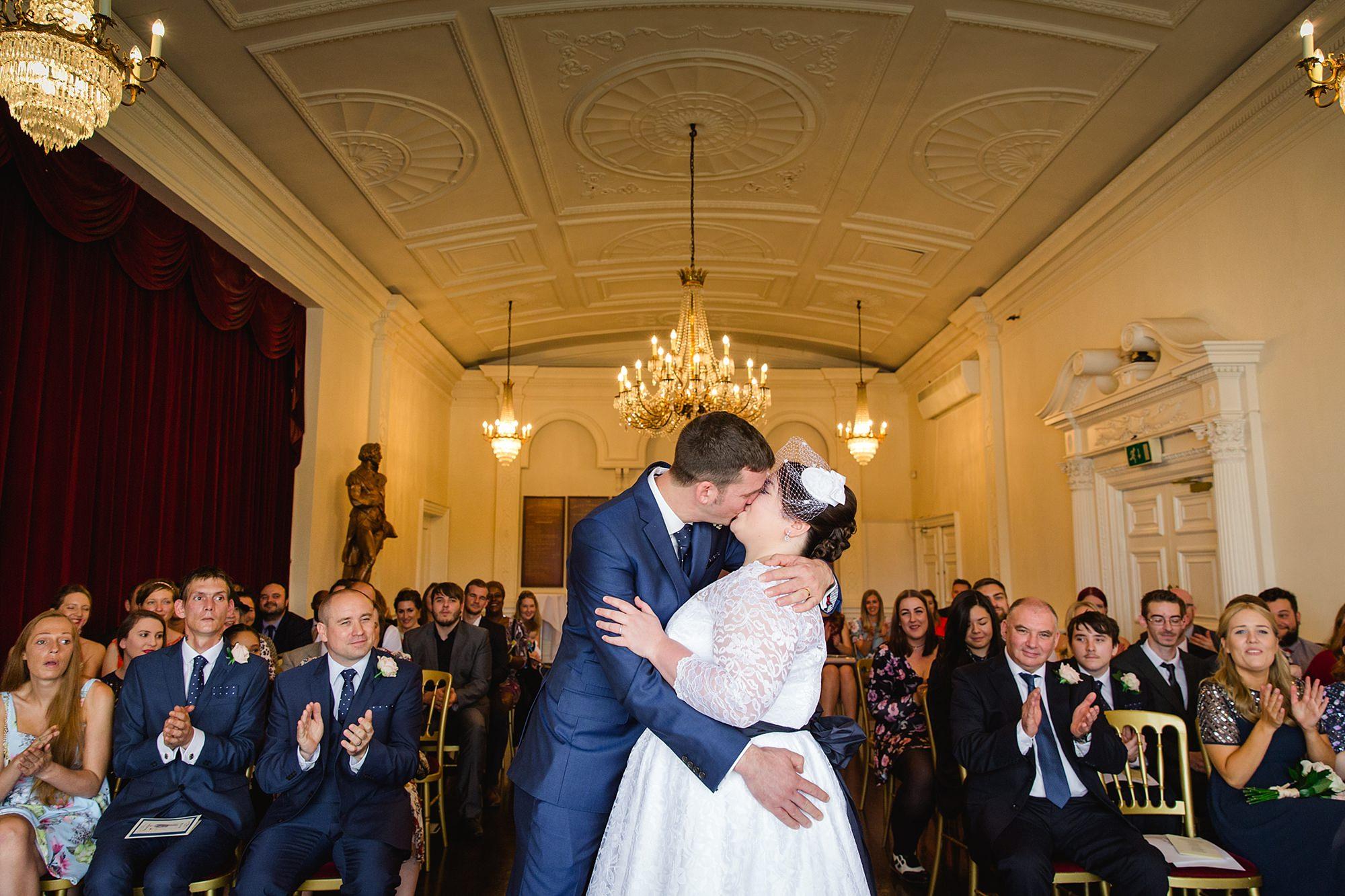 Trafalgar Tavern wedding bride and groon's first kiss