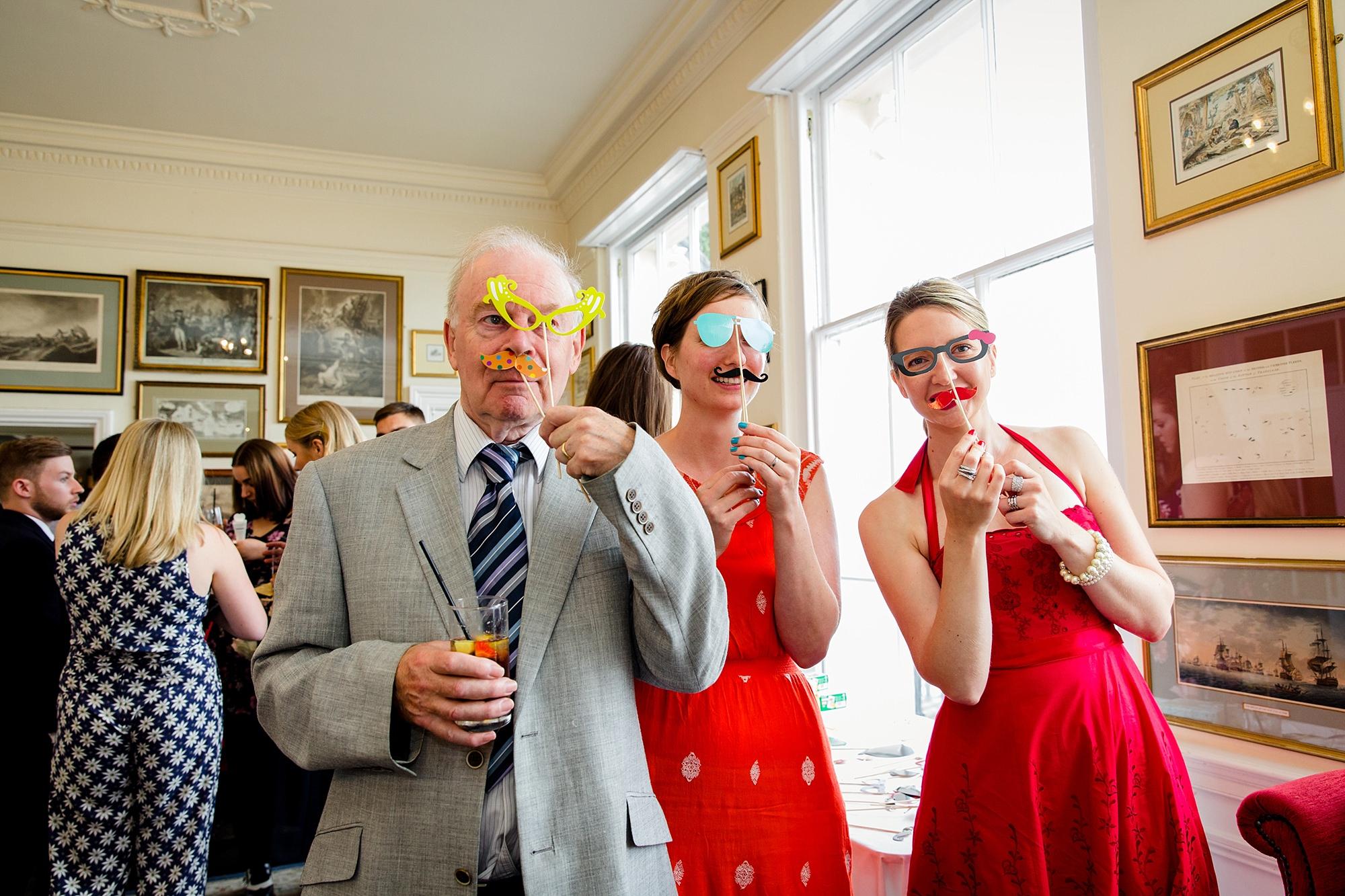 Trafalgar Tavern wedding guests with photo props