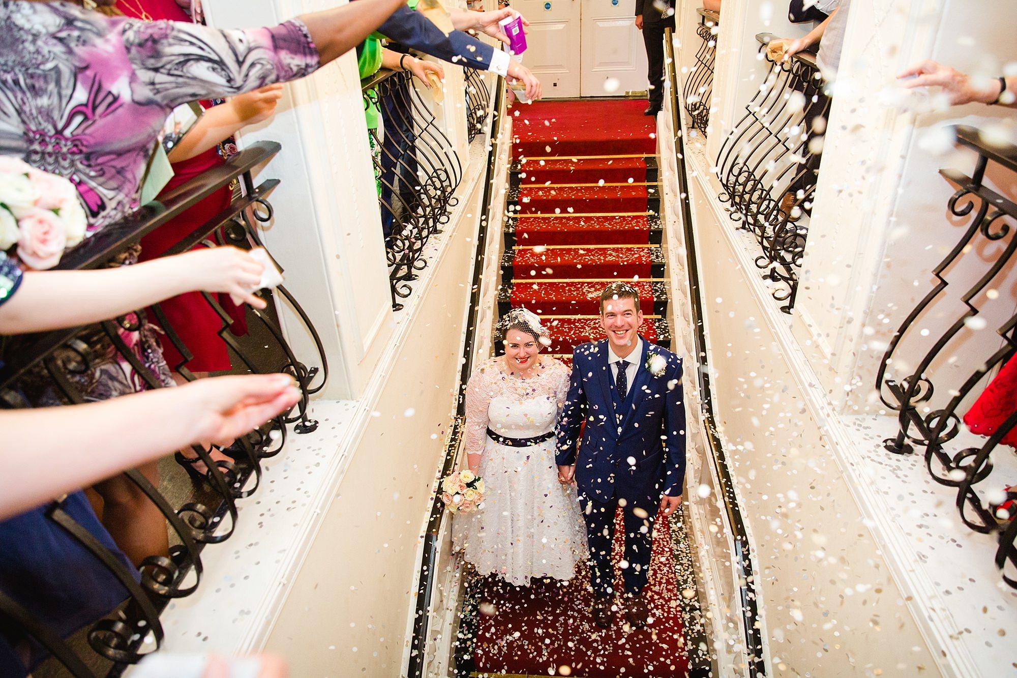 Trafalgar Tavern wedding bride and groom in confetti