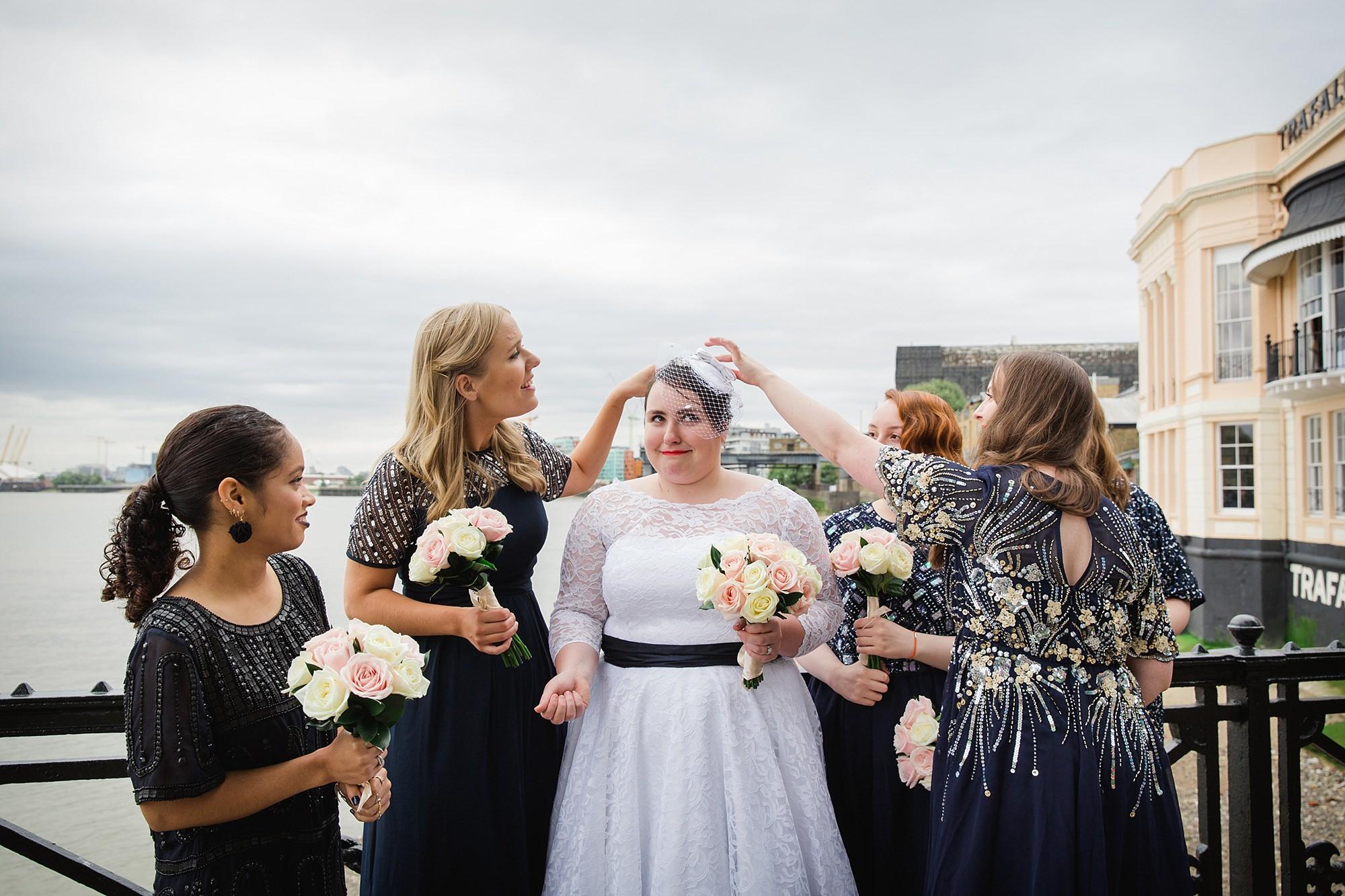 Trafalgar Tavern wedding bridesmaids get confetti out of bride's hair