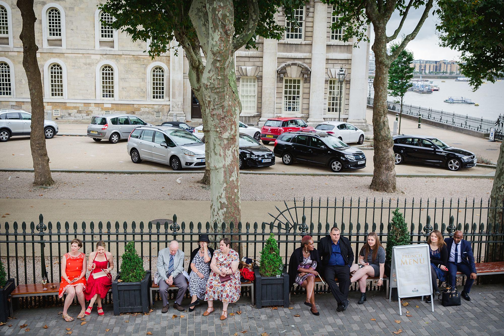 Trafalgar Tavern wedding guests chatting outside pub