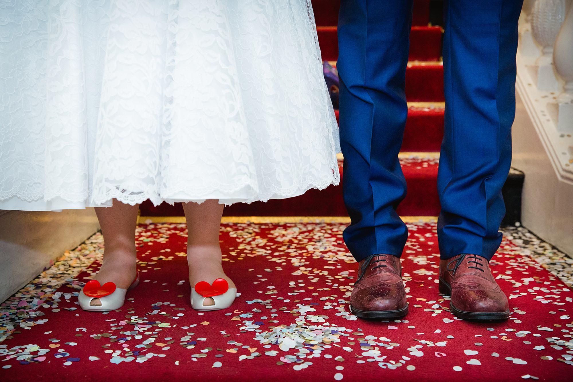 Trafalgar Tavern wedding bride and groom's shoes in confetti