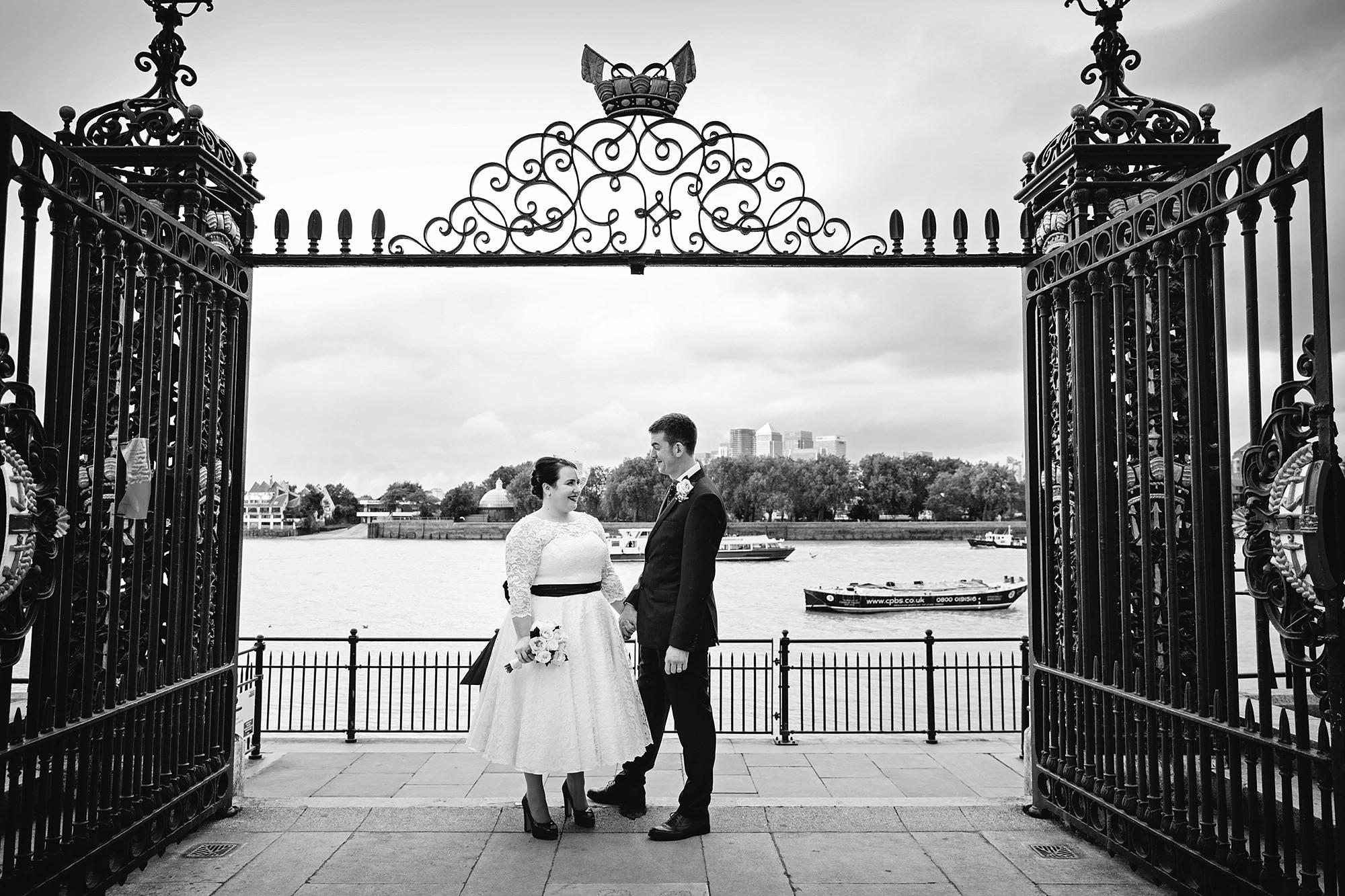 Trafalgar Tavern wedding bride and groom portrait in front of river
