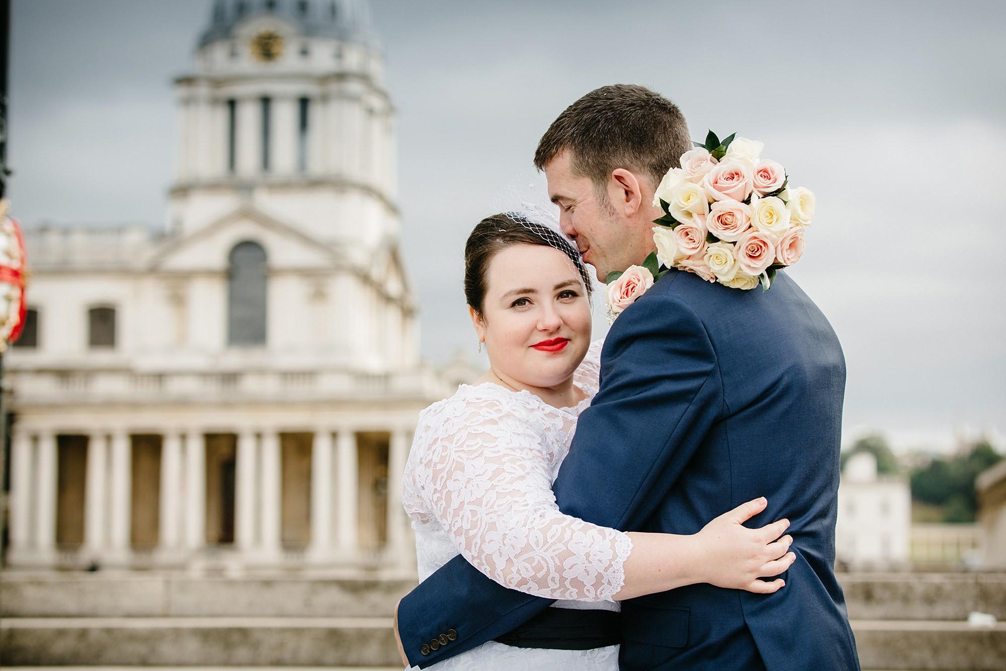 Trafalgar Tavern wedding groom kissing bride