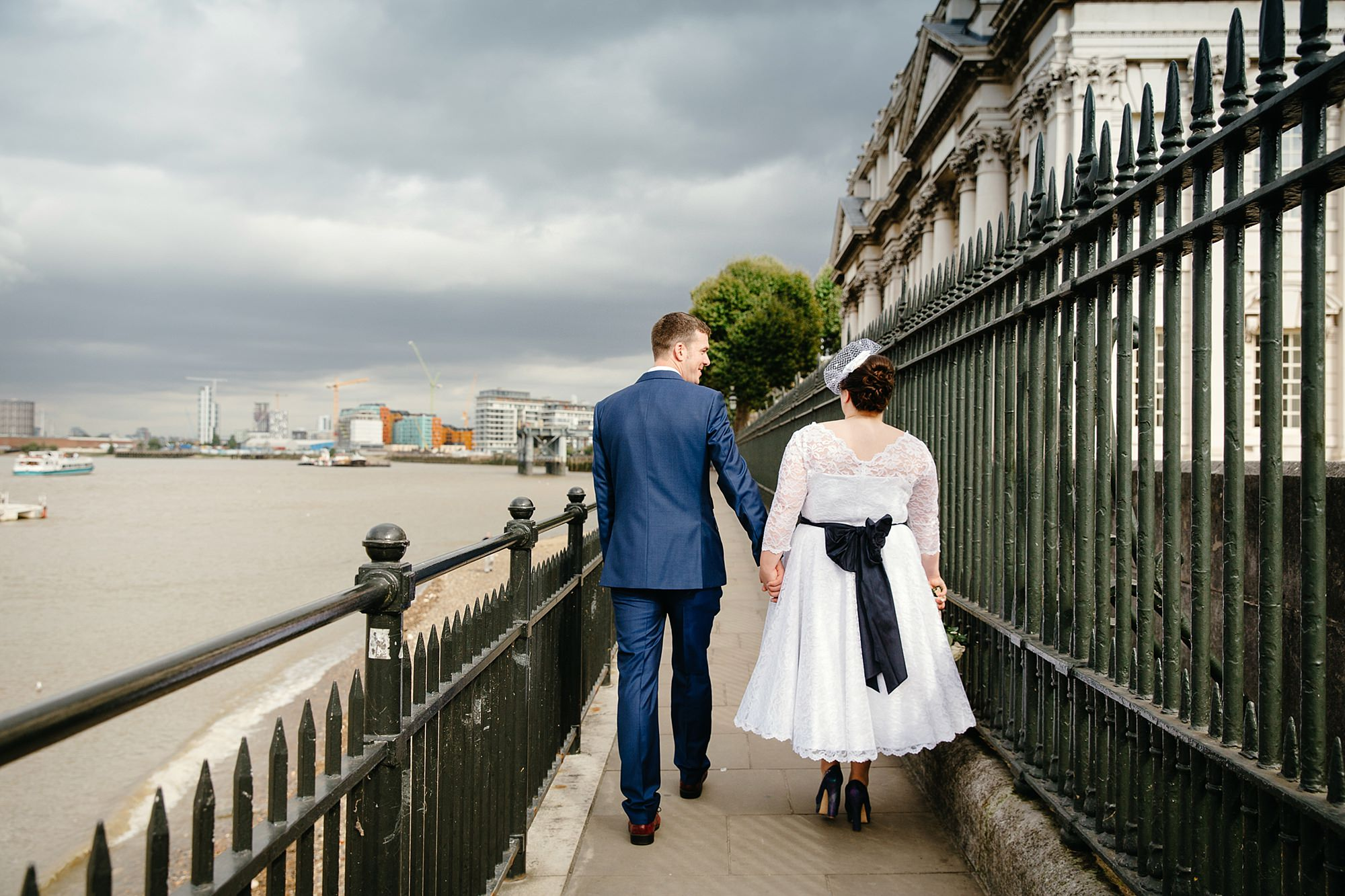 Trafalgar Tavern wedding bride and groom walk by the Thames river