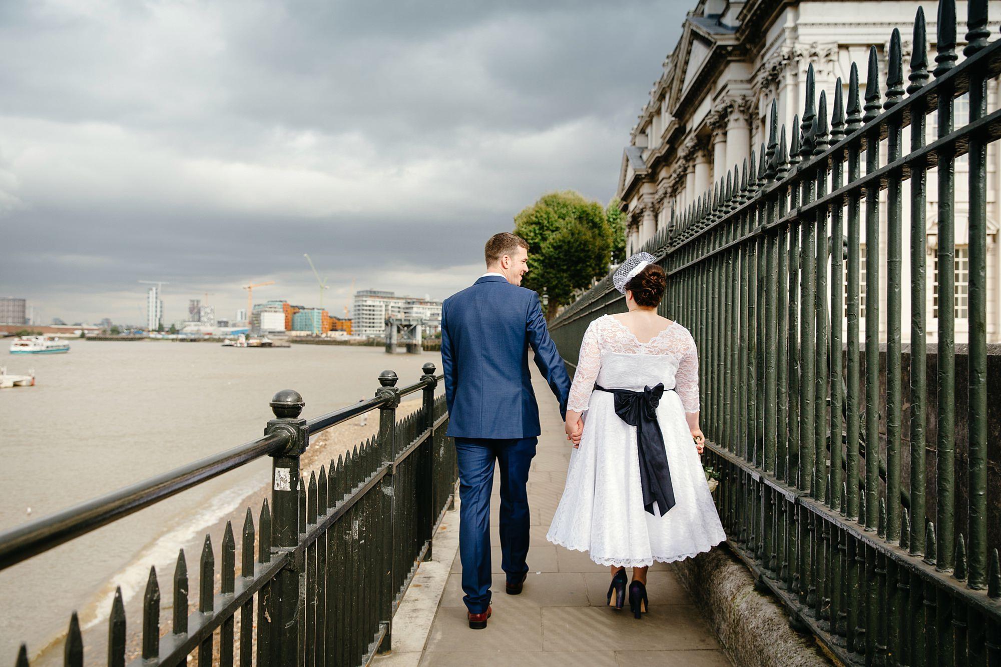 Trafalgar Tavern wedding bride and groom walk by the Thames river