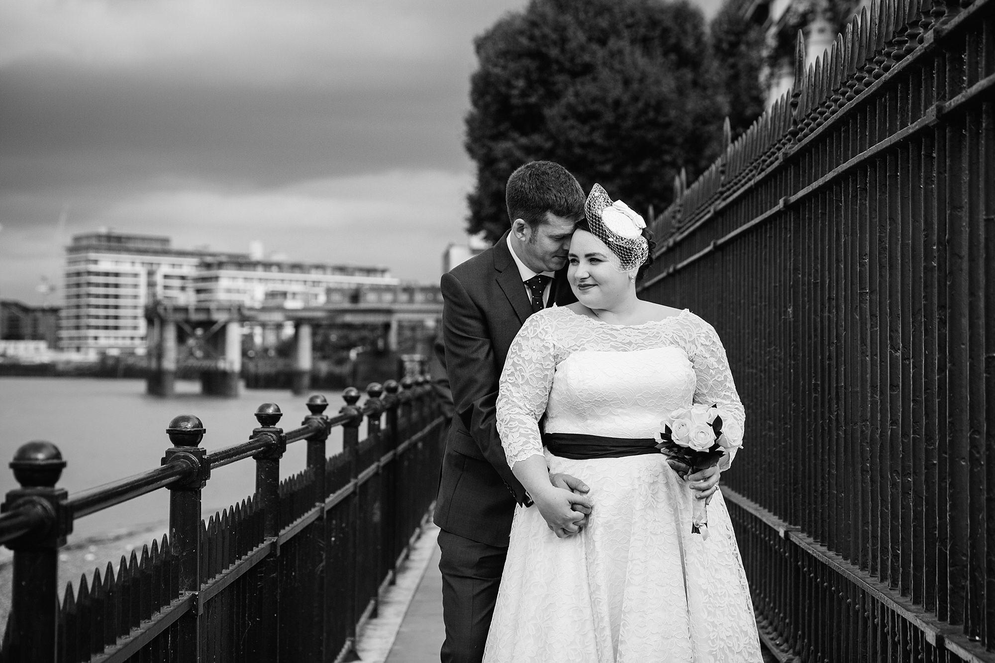 Trafalgar Tavern wedding groom hugs bride by the Thames