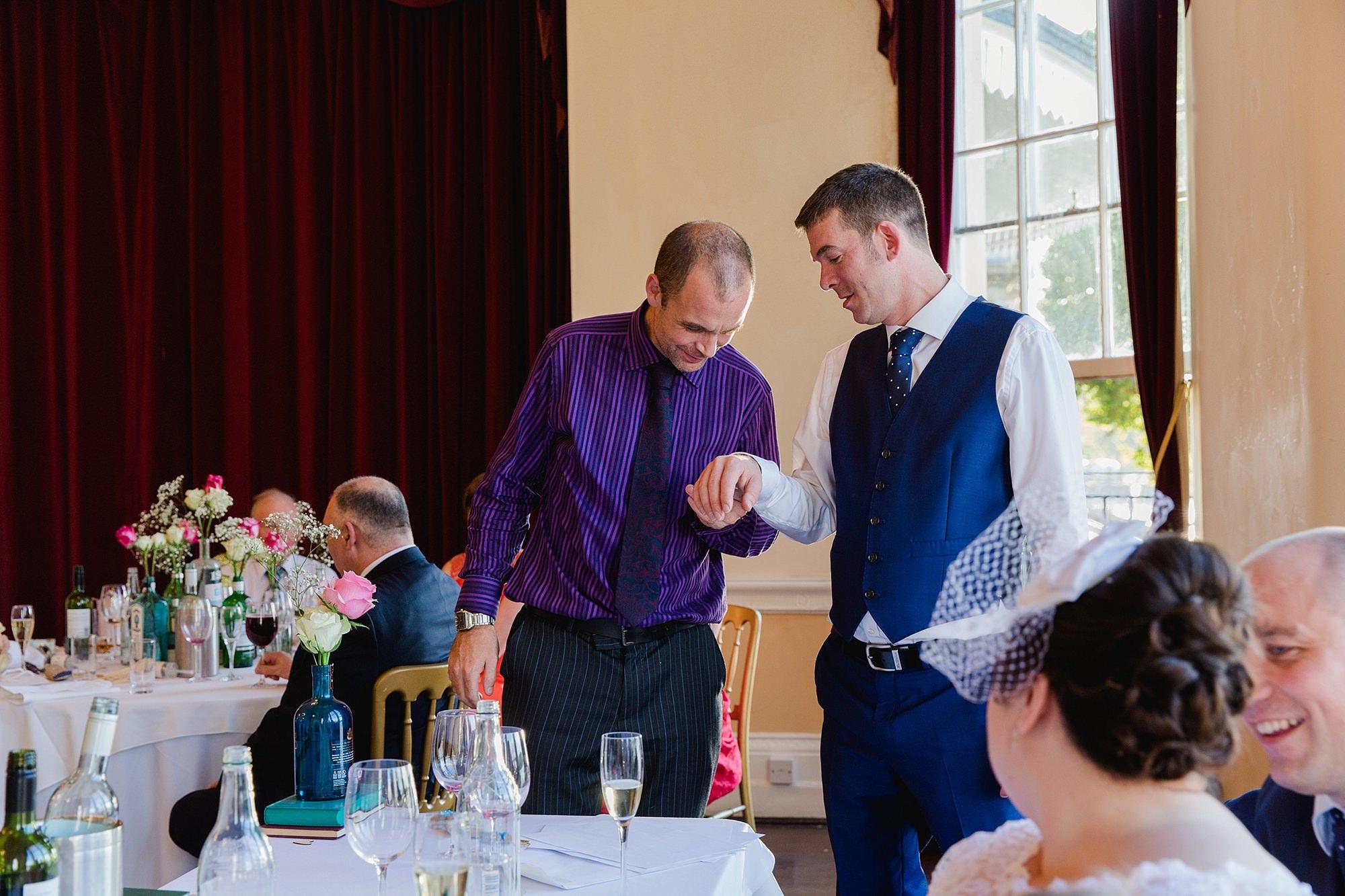 Trafalgar Tavern wedding groom showing off his wedding ring