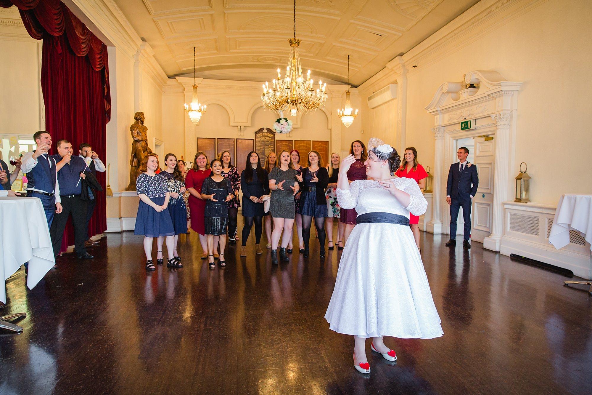 Trafalgar Tavern wedding bride throws bouquet