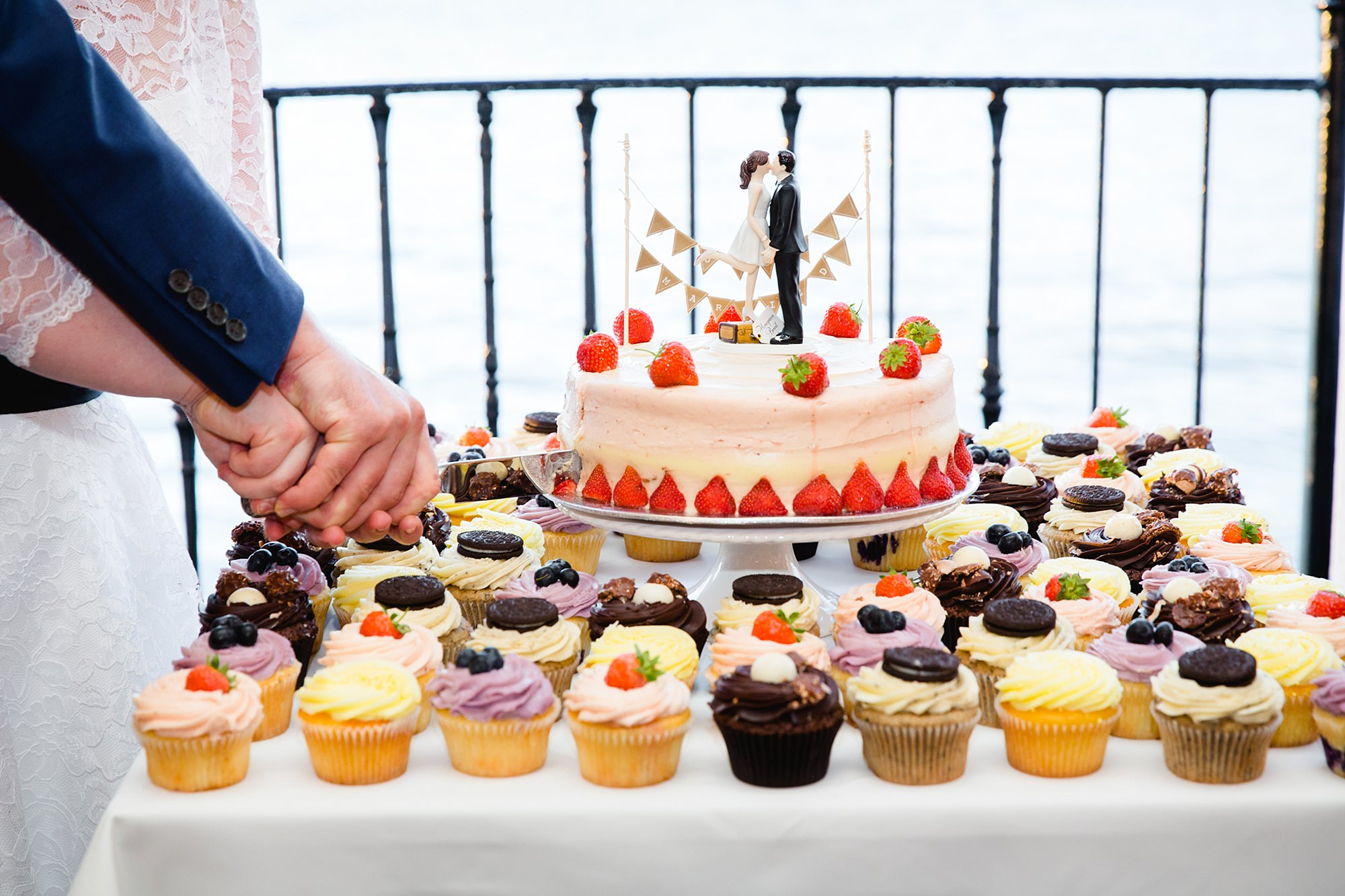 Trafalgar Tavern wedding close up detail of cutting the cake