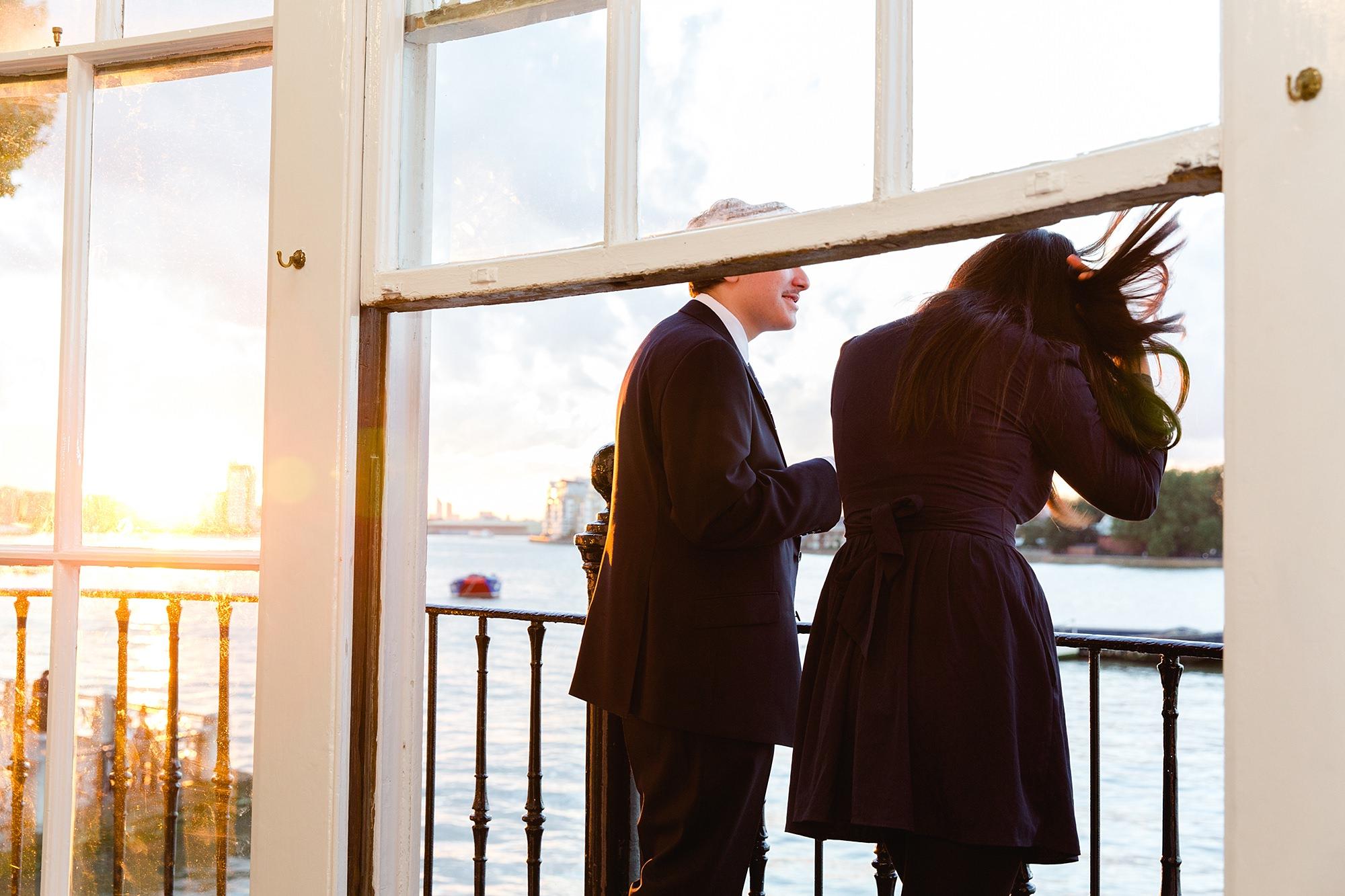 Trafalgar Tavern wedding guests enjoy sunset on the balcony