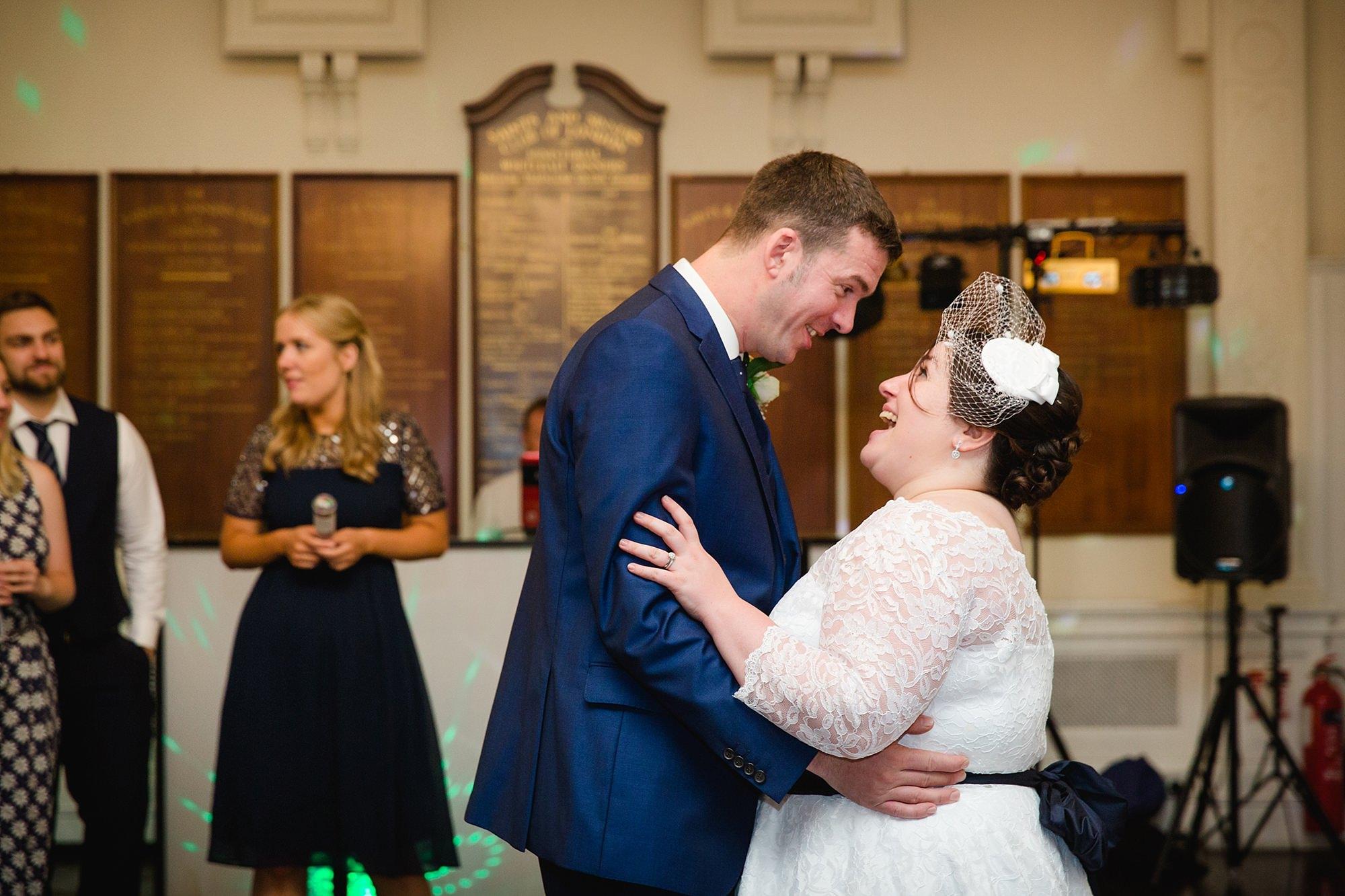 Trafalgar Tavern wedding bride and groom laugh during first dance