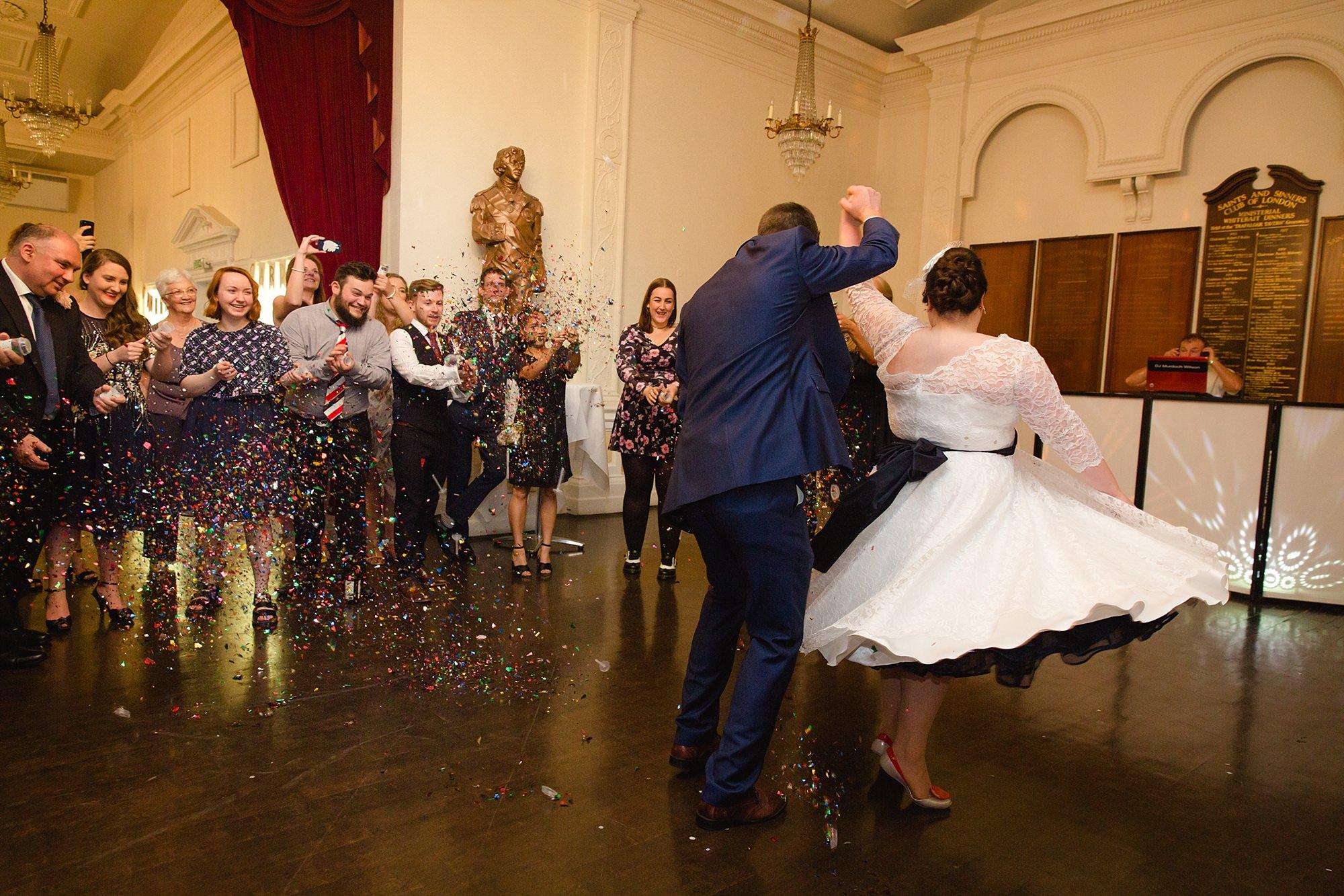Trafalgar Tavern wedding groom twirls the bride during their first dance